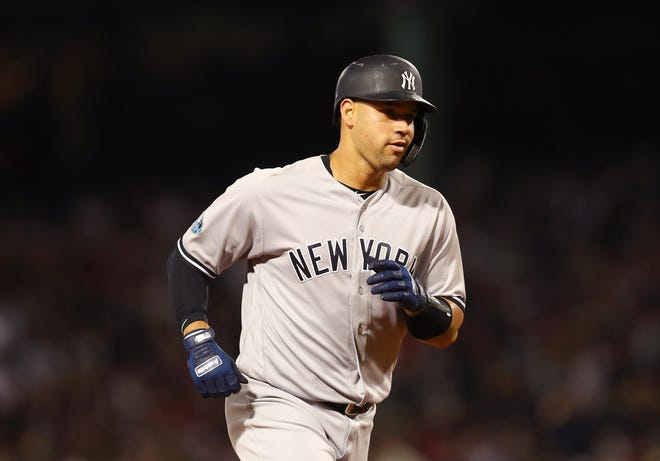 BOSTON, MA - OCTOBER 06: Gary Sanchez #24  of the New York Yankees jogs toward home plate on his solo home run during the second inning of Game Two of the American League Division Series against the Boston Red Sox at Fenway Park on October 6, 2018 in Boston, Massachusetts.