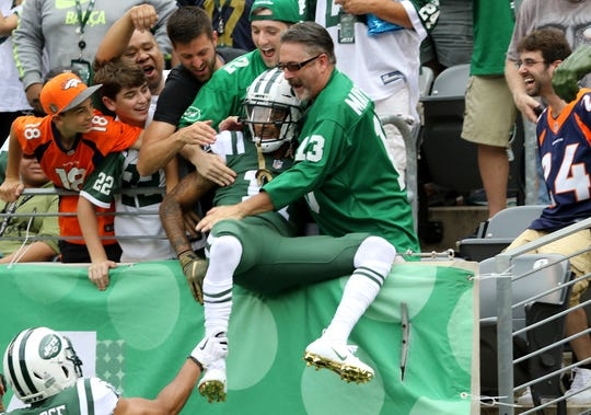 Robby Anderson jumped into the stands after one of his two touchdowns, to celebrate with friends.  Sunday, October 7, 2018