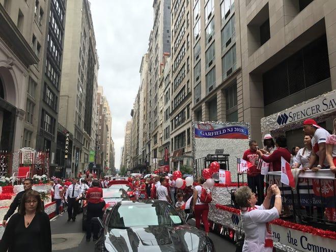 Revelers prepare to march in the Pulaski Day Parade in Manhattan.