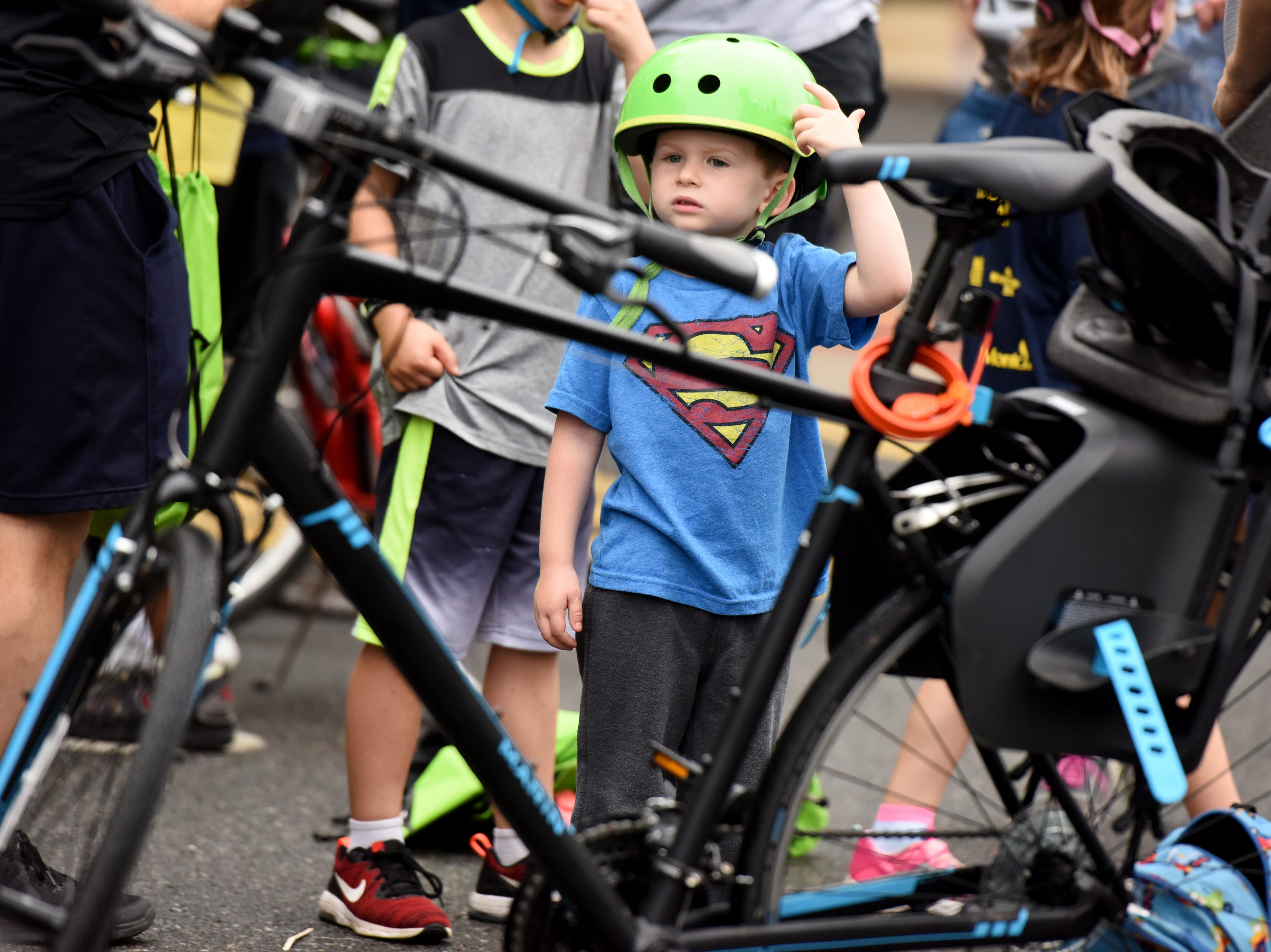 The Tour de Montclair a family-friendly bike ride with 6- and 12- mile options was held on Sunday, October 7, 2018. Samuel Lippman 4, of Glen Ridge, adjusts his helmet while waiting for the ride to leave from Crane Park.