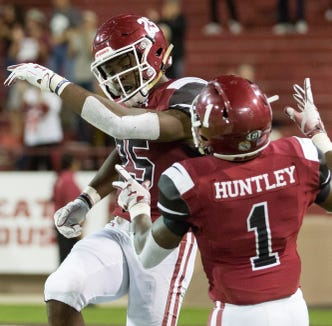 Christian Gibson, left, and Jason Huntley celebrate after scoring a touchdown on Saturday, Oct. 6, 2018 at Aggie Memorial Stadium.
