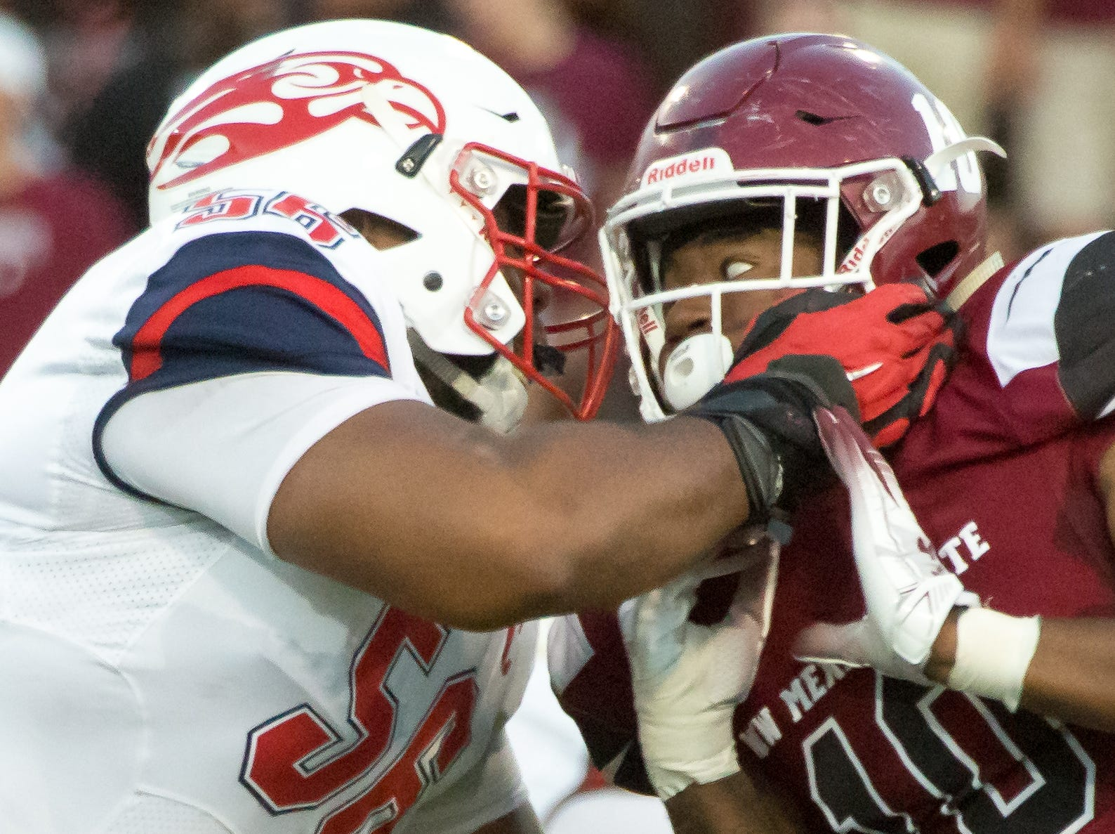New Mexico State University's Cedric Wilcots II and Liberty's Dontae Duff battle on Saturday, Oct. 6, 2018 at the Aggie Memorial Stadium.