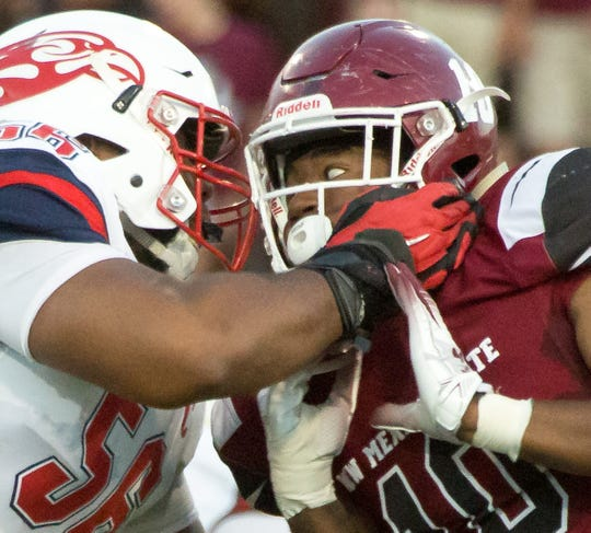 New Mexico State University's Cedric Wilcots II and Liberty's Dontae Duff battle on Saturday, Oct. 6, 2018 at Aggie Memorial Stadium.