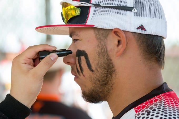 Imperial team memebr Andres Salazar gets eye black put on before the start of tournament play on Sunday, Oct. 7, 2018 during the 39th Whole Enchilada Invitational softball tournament at the Hadley complex.