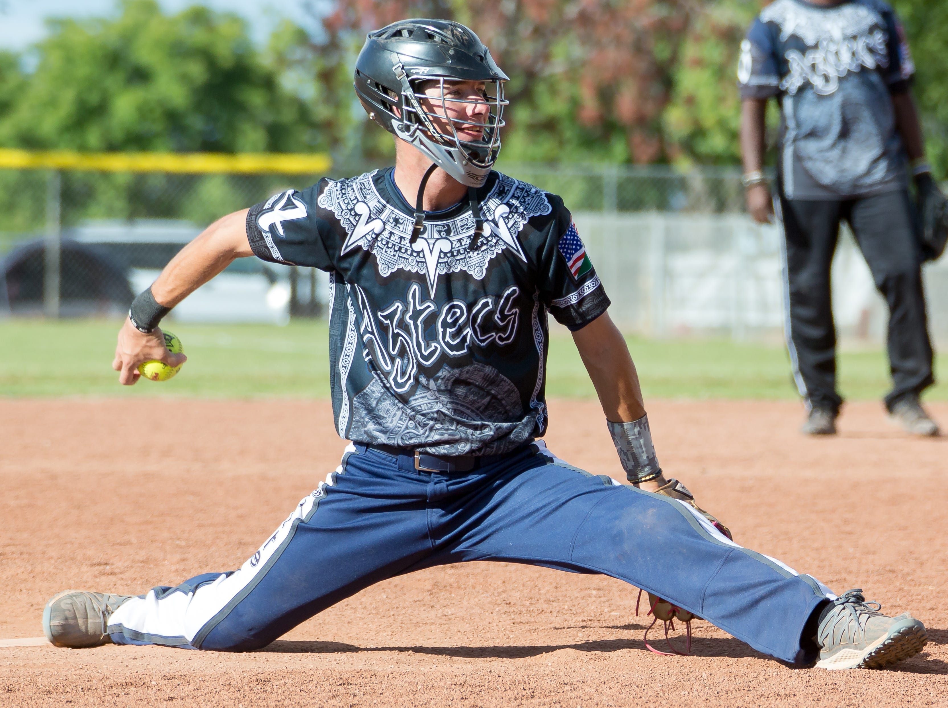 Jesse Jones, of Las Vegas, Nevada, does a split while pitching  on Sunday, Oct. 7, 2018 during the 39th Whole Enchilada Invitational softball tournament at the Hadley complex.