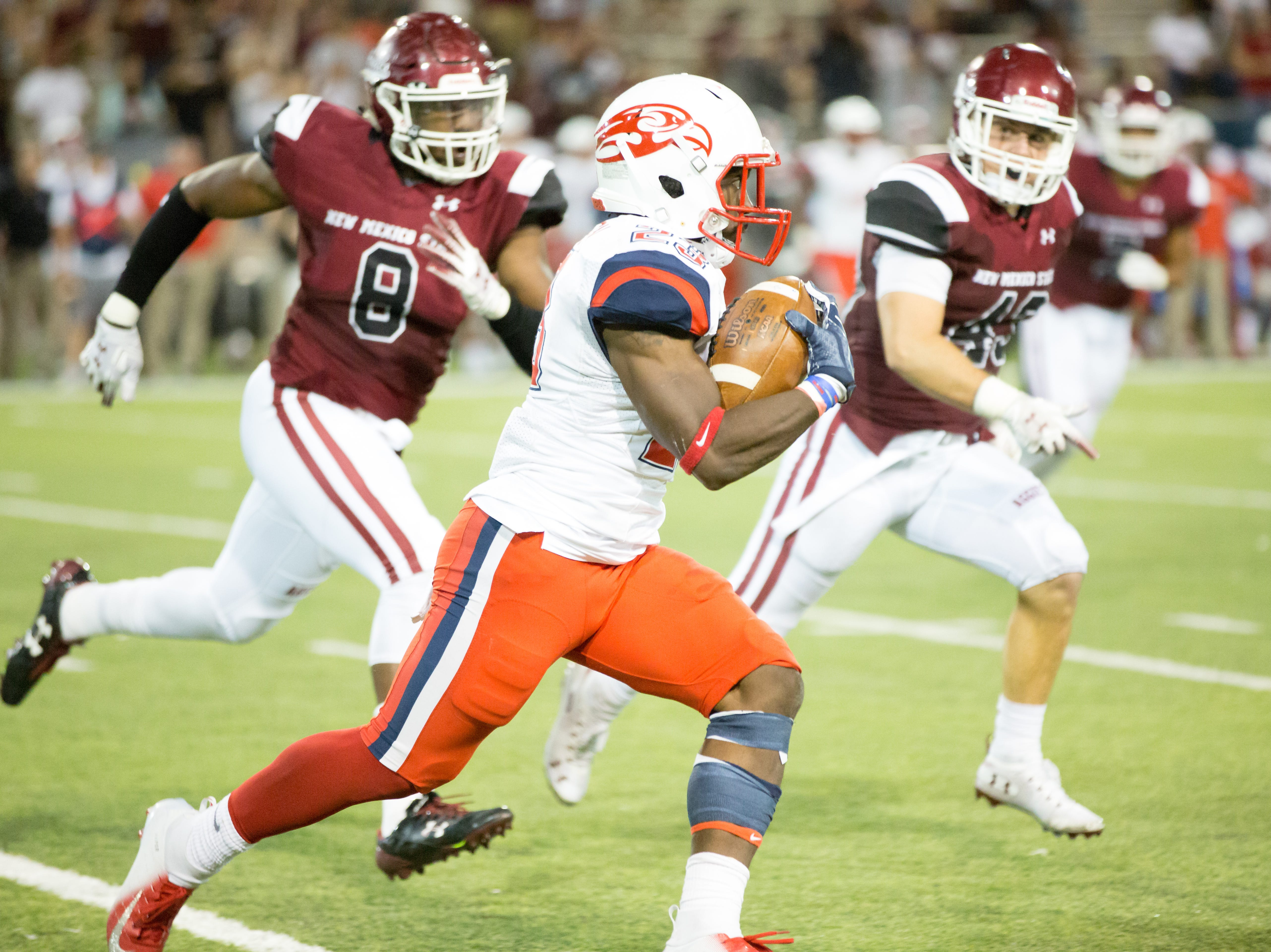 Liberty's Frankie Hickson runs with the ball as NMSU defenders try to close in on him Saturday, Oct., 6 2018, at Aggie Memorial Center.