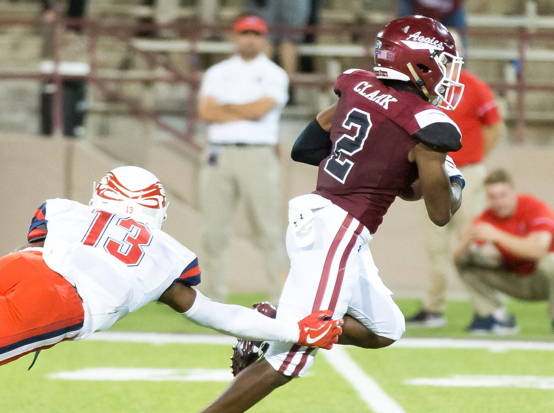 NMSU wide receiver OJ Clark, runs the ball in for a touchdown as Liberty defender Isaac Steele tries to make the stop on Saturday, Oct. 6, 2018, at the Aggie Memorial Stadium.