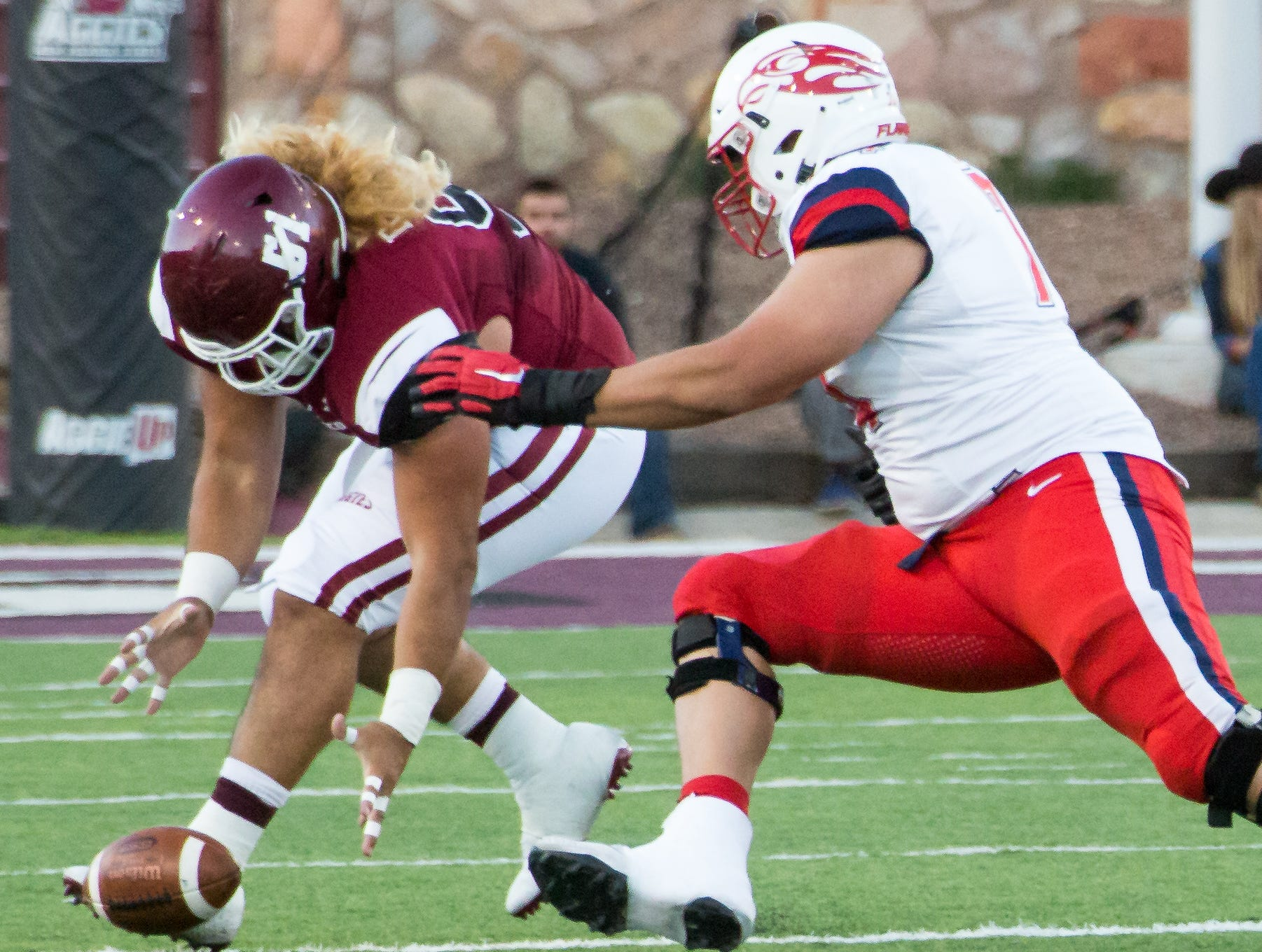 NMSU's Roy Lopez picks up a fumble on Saturday, Oct. 6, 2018 at Aggie Memorial Stadium as Liberty's Julio Lozano also tries to go for the ball.