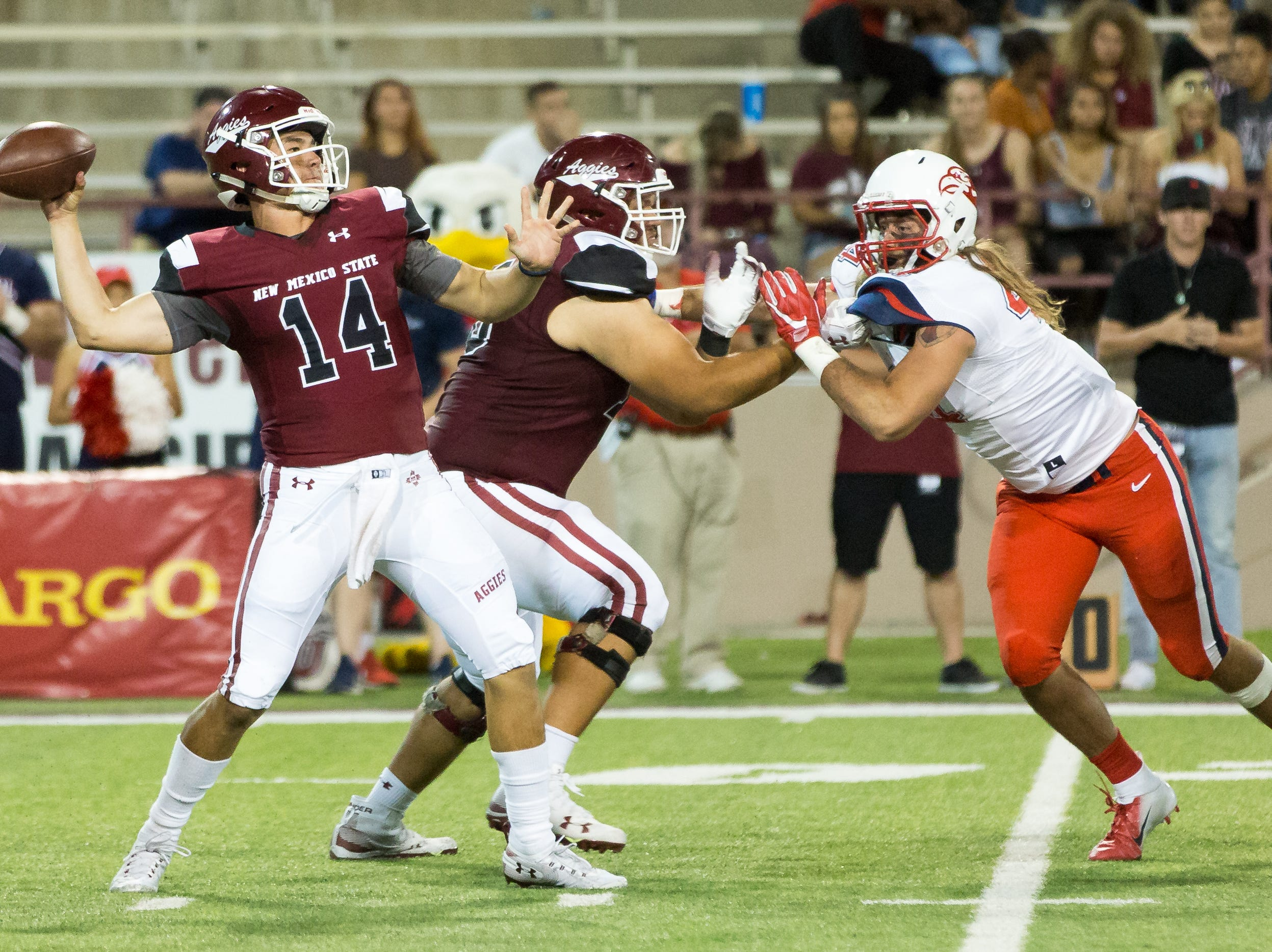 NMSU quarterback Josh Adkins throws the ball while playing against Liberty on Saturday, Oct. 6, 2018 at Aggie Memorial Stadium.