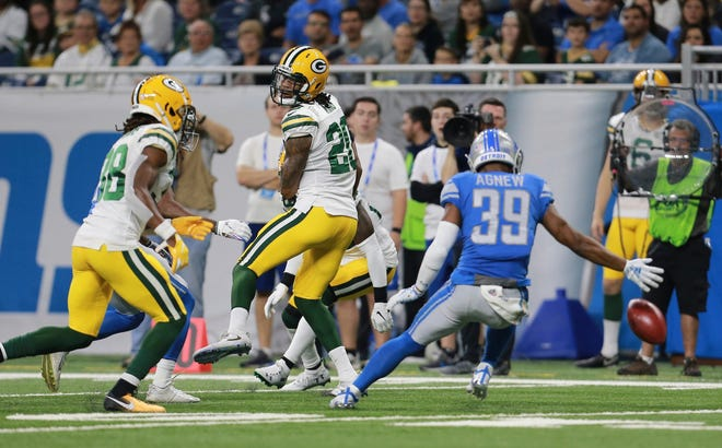 Detroit Lions cornerback Jamal Agnew (39) reaches for the ball as Green Bay Packers cornerbacks Kevin King (20) and Tramon Williams (38) misplay the punt by the Lions during the first half of an NFL football game, Sunday, Oct. 7, 2018, in Detroit.