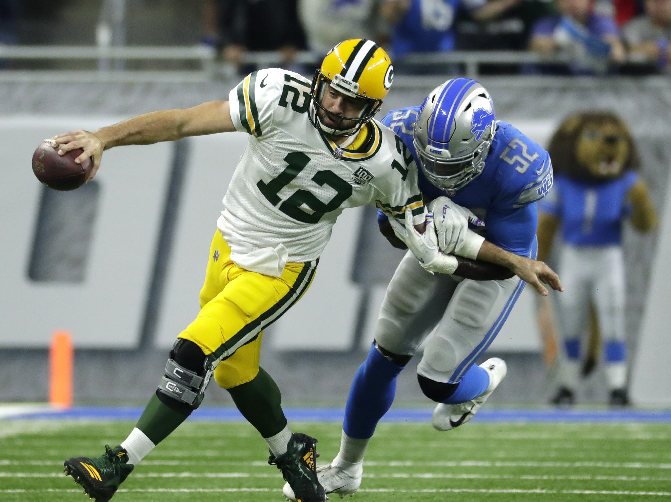 Green Bay Packers quarterback Aaron Rodgers (12) is sacked by Detroit Lions linebacker Christian Jones (52) during the Green Bay Packers vs. Detroit Lions NFL game at Ford Field, Detroit, Sunday, October 7, 2018.