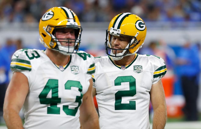 Green Bay Packers kicker Mason Crosby (2) walks off the field with teammate Hunter Bradley (43) after missing his third field goal of the day during the first half of an NFL football game against the Detroit Lions, Sunday, Oct. 7, 2018, in Detroit.