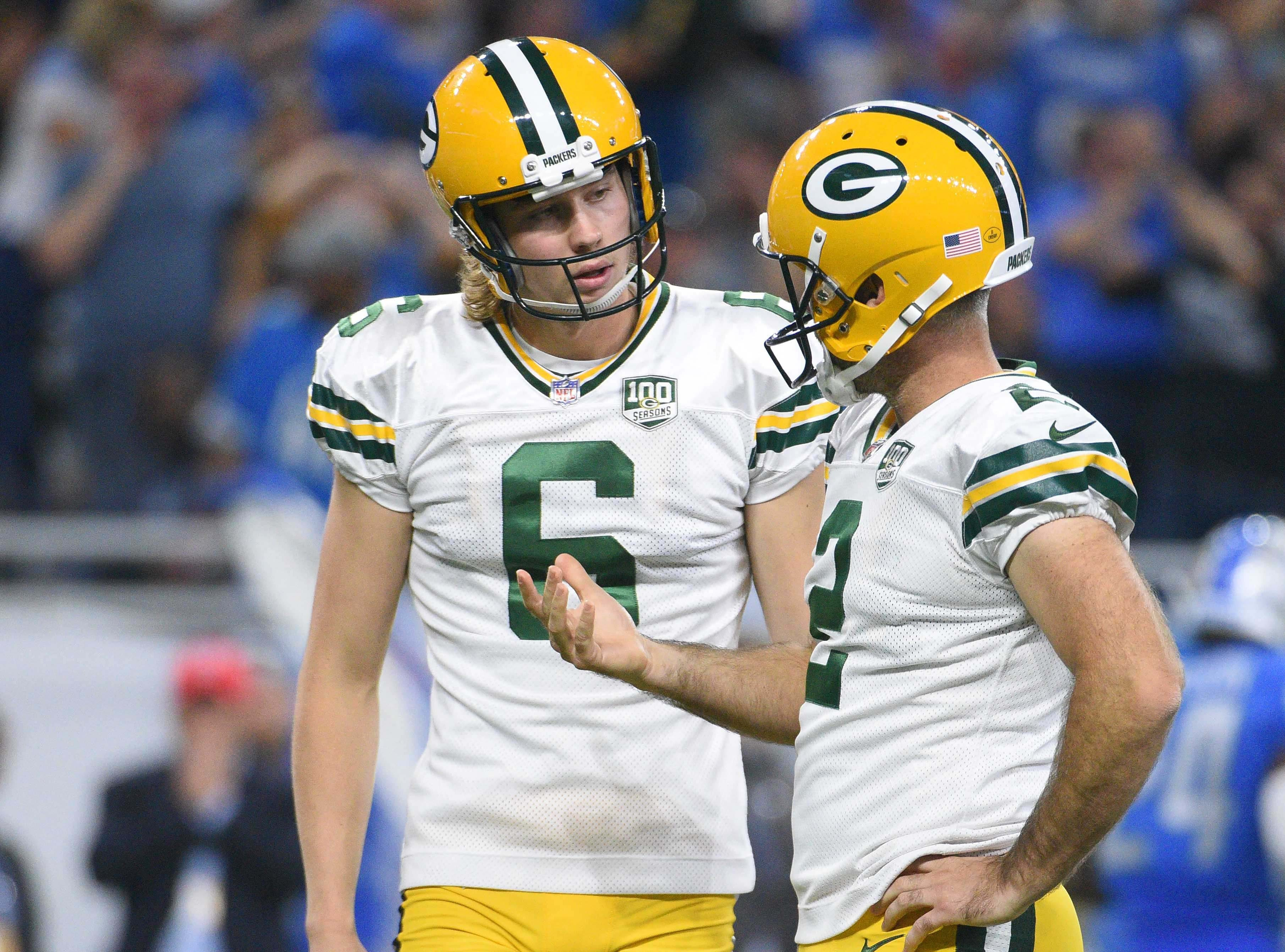 Oct 7, 2018; Detroit, MI, USA; Green Bay Packers kicker Mason Crosby (2) talks to punter JK Scott (6) after missing a field goal during the game against the Detroit Lions at Ford Field. Mandatory Credit: Tim Fuller-USA TODAY Sports