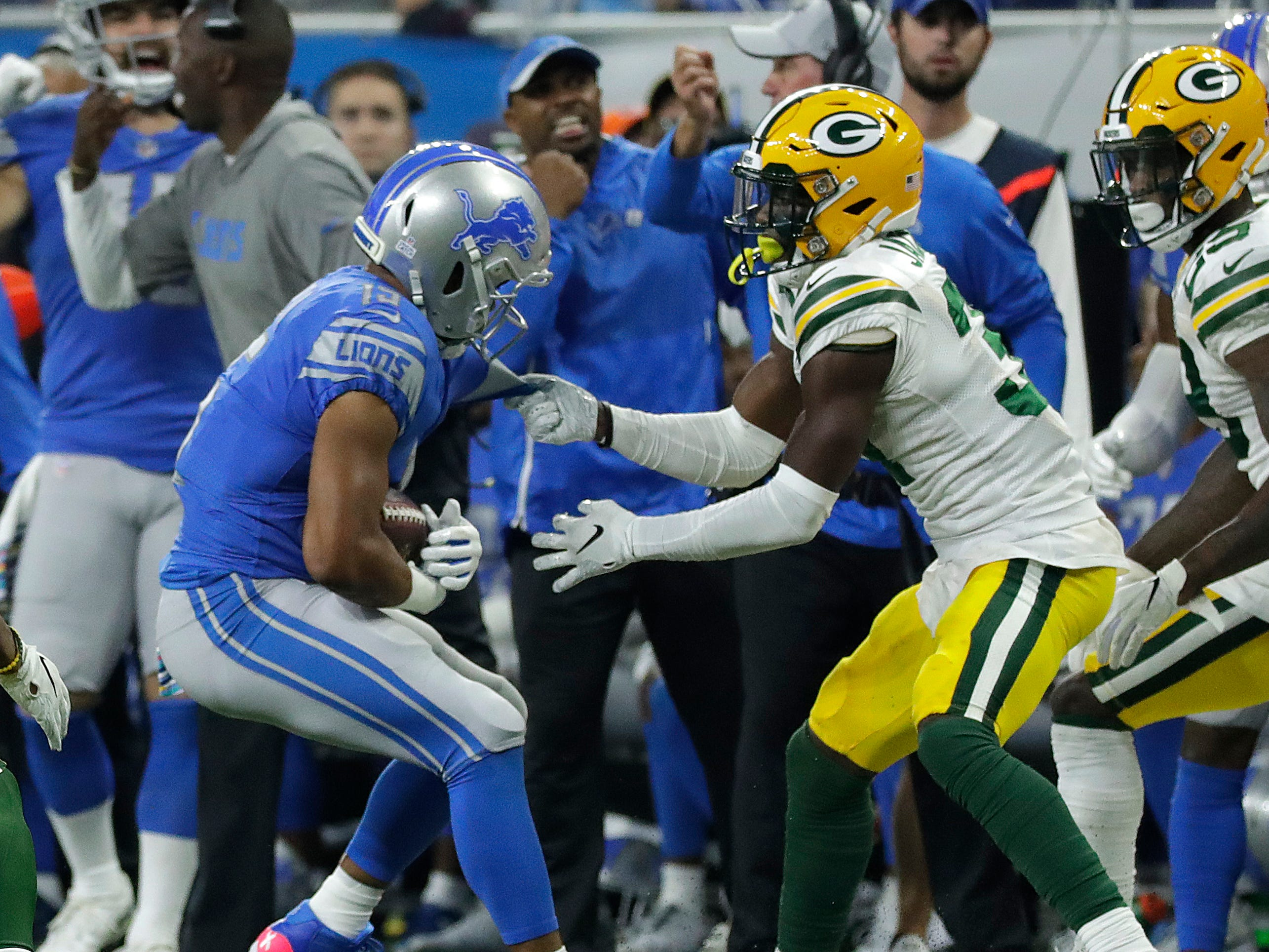 Penalties hurt the Green Bay Packers as cornerback Josh Jackson (37)] is called for face mask against Detroit Lions wide receiver Golden Tate (15) in the fourth quarter during the Green Bay Packers 31-23 loss to the Detroit Lions at Ford Field, Detroit, Sunday, October 7, 2018.   Rick Wood/Milwaukee Journal Sentinel. USA
