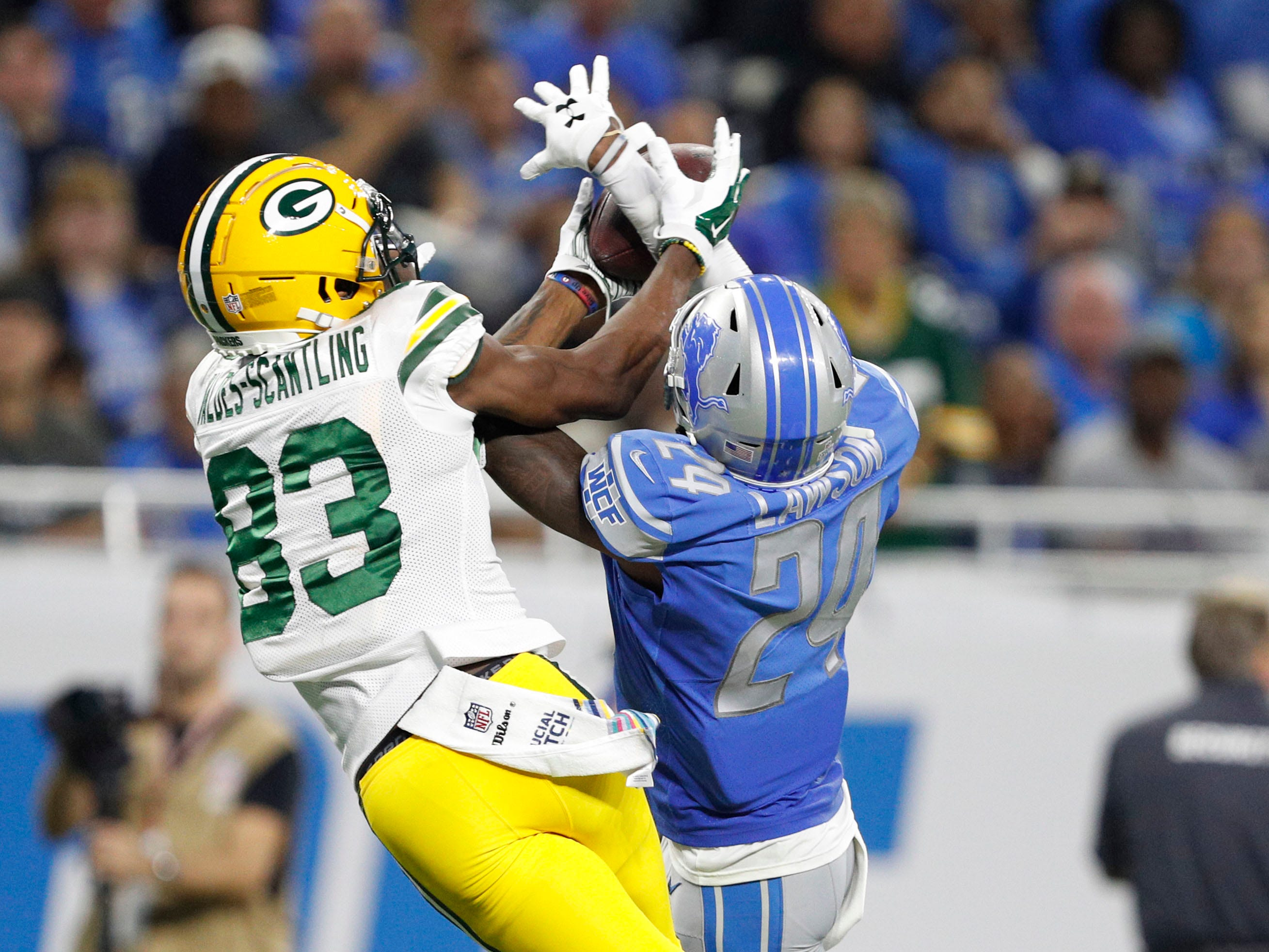 Oct 7, 2018; Detroit, MI, USA; Green Bay Packers wide receiver Marquez Valdes-Scantling (83) unable to make a catch against Detroit Lions cornerback Nevin Lawson (24) during the second quarter at Ford Field.