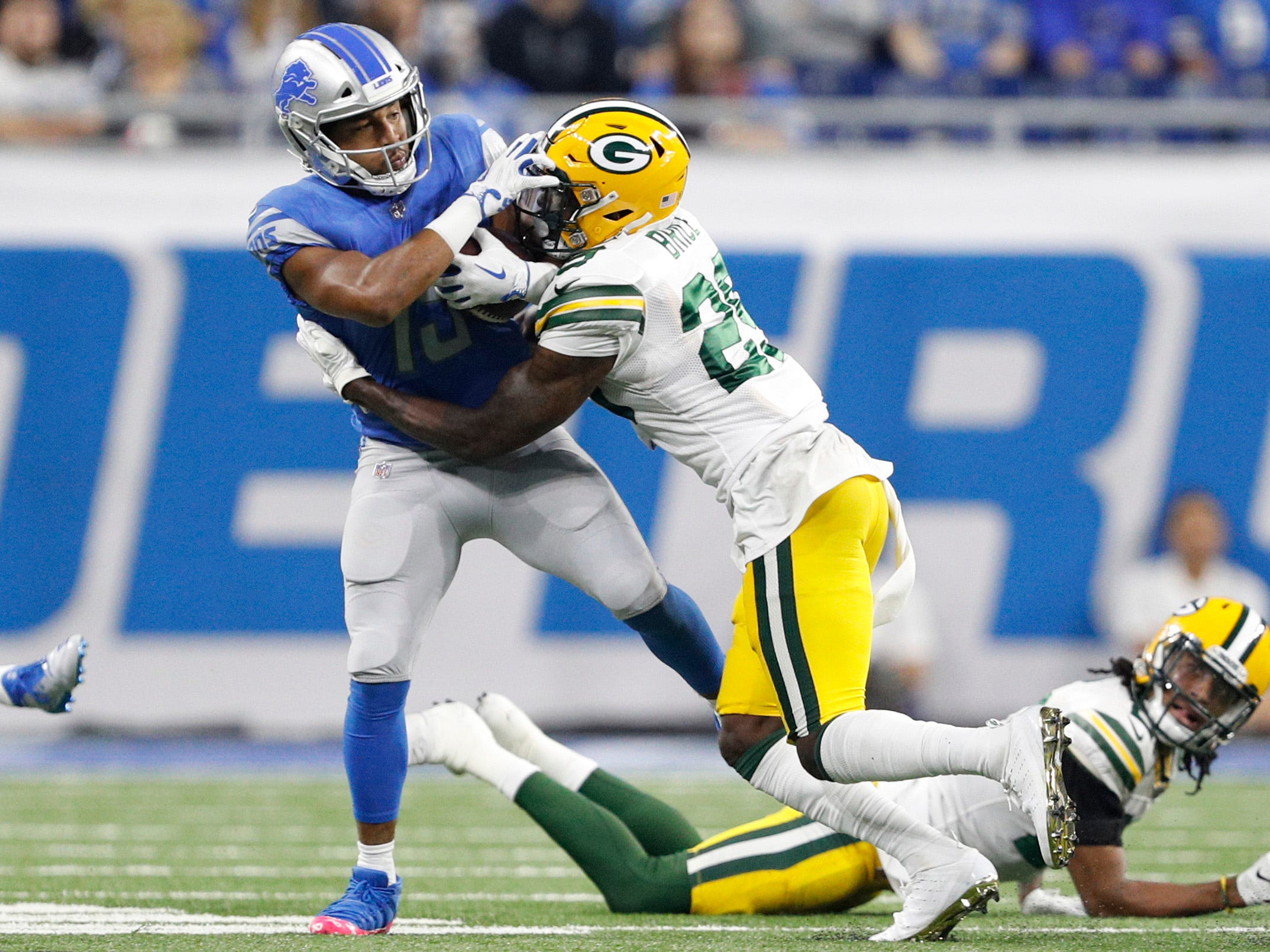 Oct 7, 2018; Detroit, MI, USA; Green Bay Packers strong safety Kentrell Brice (29) tries to tackle Detroit Lions wide receiver Golden Tate (15) during the second quarter at Ford Field.