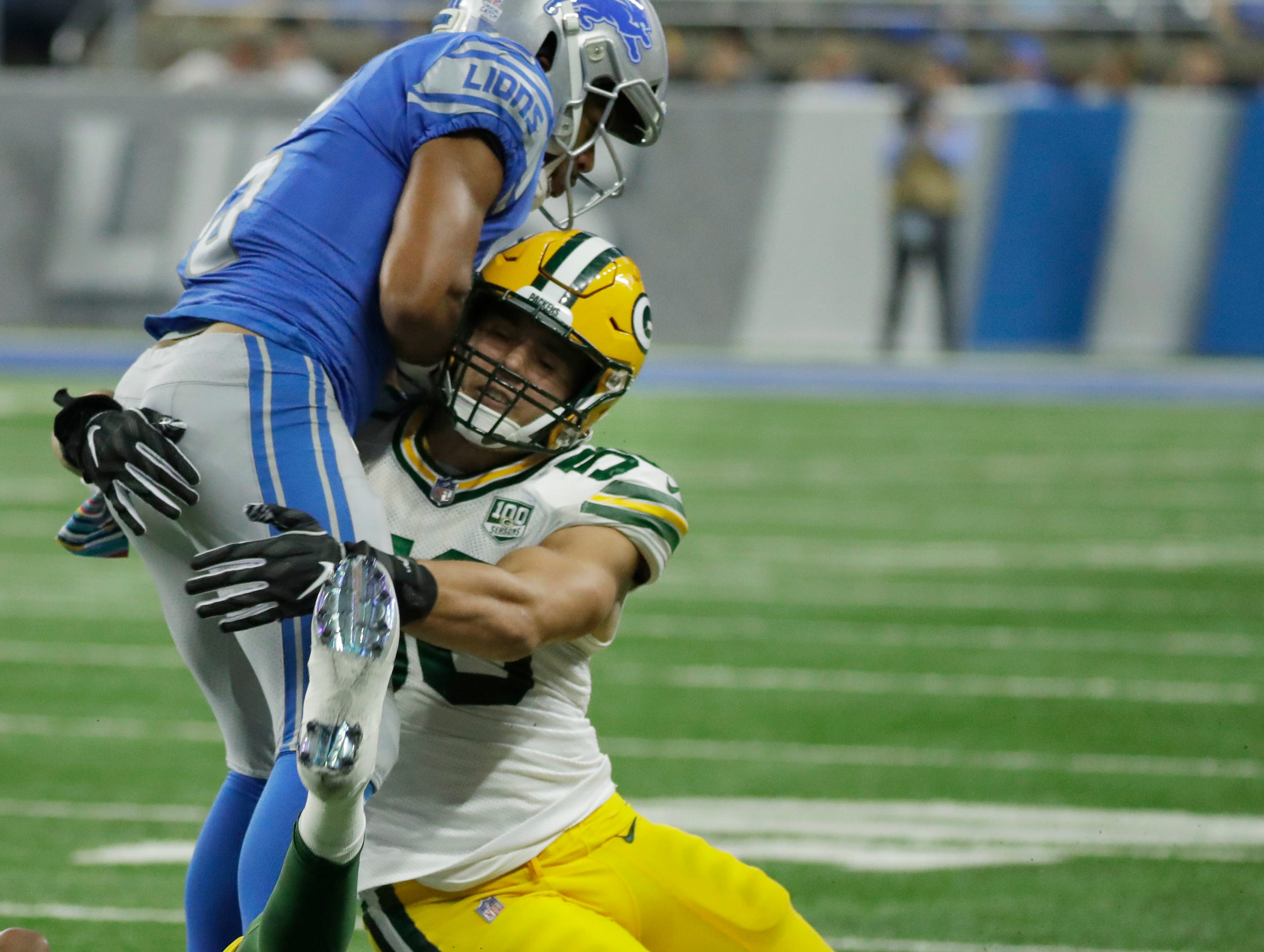 Green Bay Packers linebacker Blake Martinez (50) tackles Detroit Lions wide receiver Golden Tate (15) during the Green Bay Packers 31-23 loss to the Detroit Lions at Ford Field, Detroit, Sunday, October 7, 2018.   Rick Wood/Milwaukee Journal Sentinel. USA