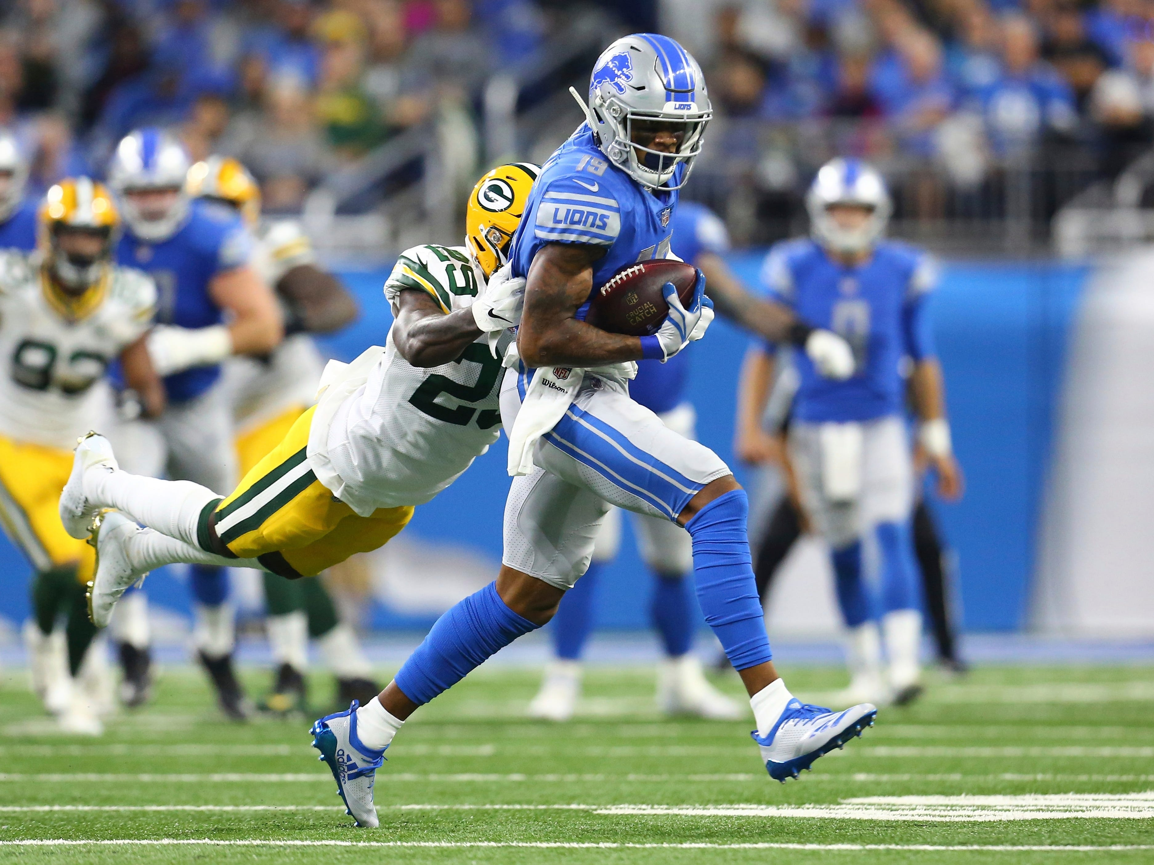 Detroit Lions wide receiver Kenny Golladay (19) pulls away from Green Bay Packers strong safety Kentrell Brice (29) during the first half of an NFL football game, Sunday, Oct. 7, 2018, in Detroit.