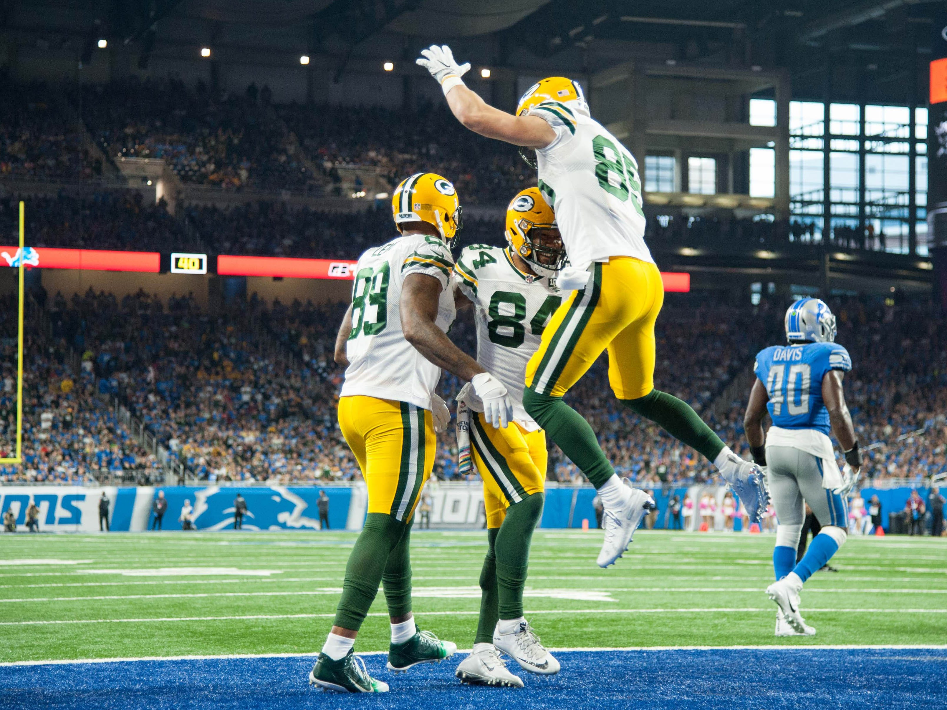 Oct 7, 2018; Detroit, MI, USA; Green Bay Packers tight end Lance Kendricks (84) celebrates his touchdown with tight end Marcedes Lewis (89) and tight end Robert Tonyan (85) during the third quarter against the Detroit Lions at Ford Field.