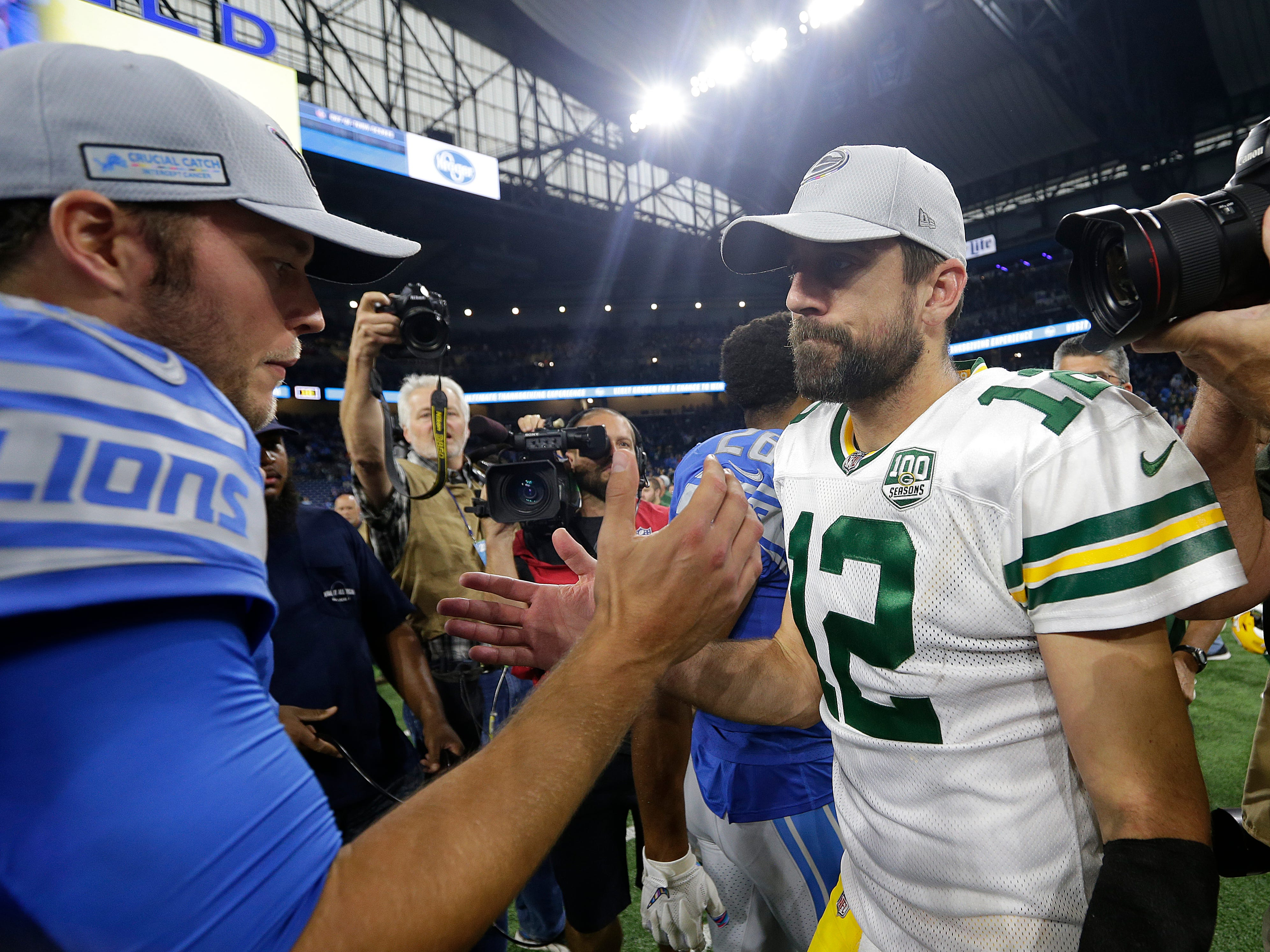 Detroit Lions quarterback Matthew Stafford (9) greets Green Bay Packers quarterback Aaron Rodgers (12) after during  Green Bay Packers 31-23 loss to the Detroit Lions at Ford Field, Detroit, Sunday, October 7, 2018.   Rick Wood/Milwaukee Journal Sentinel. USA