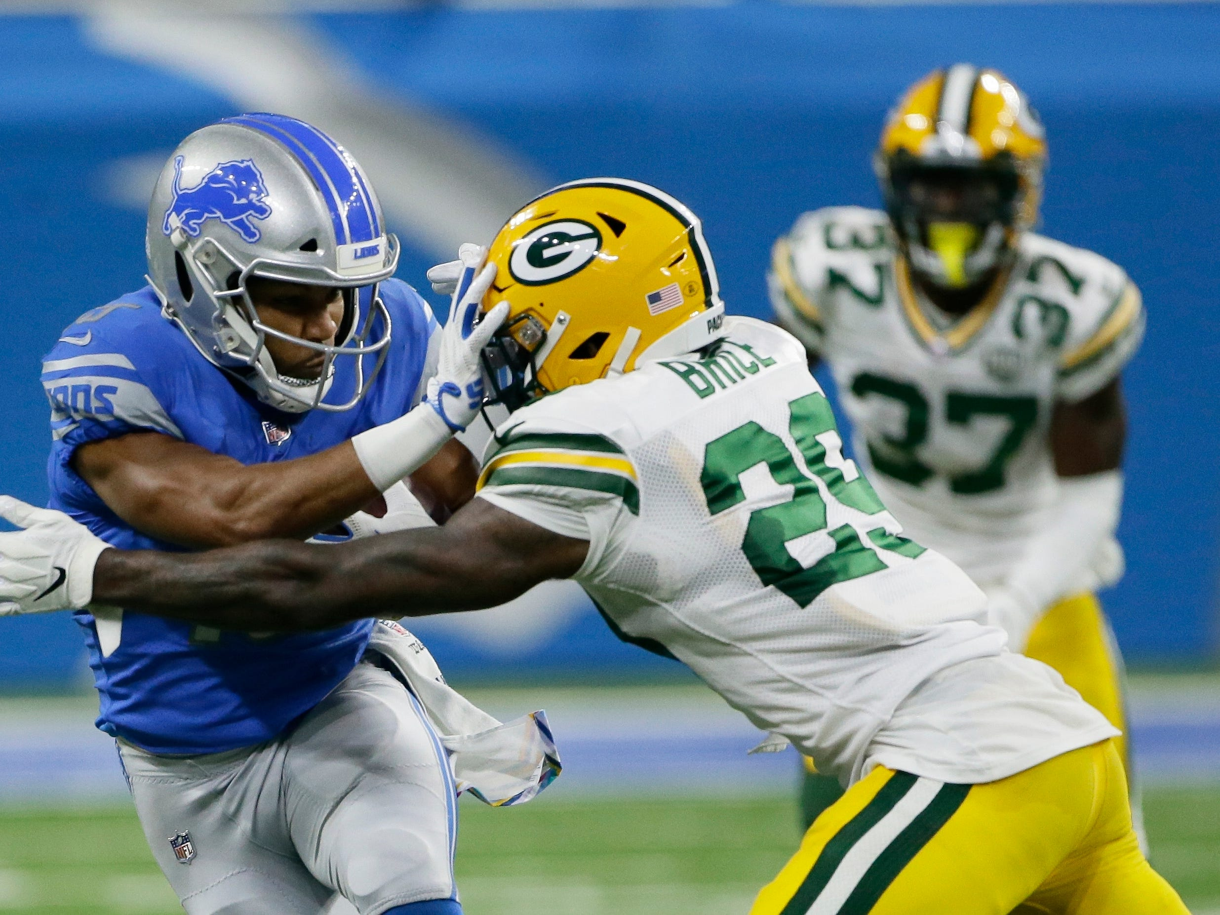 Detroit Lions wide receiver Golden Tate (15) pushes Green Bay Packers strong safety Kentrell Brice (29) during the second half of an NFL football game, Sunday, Oct. 7, 2018, in Detroit.