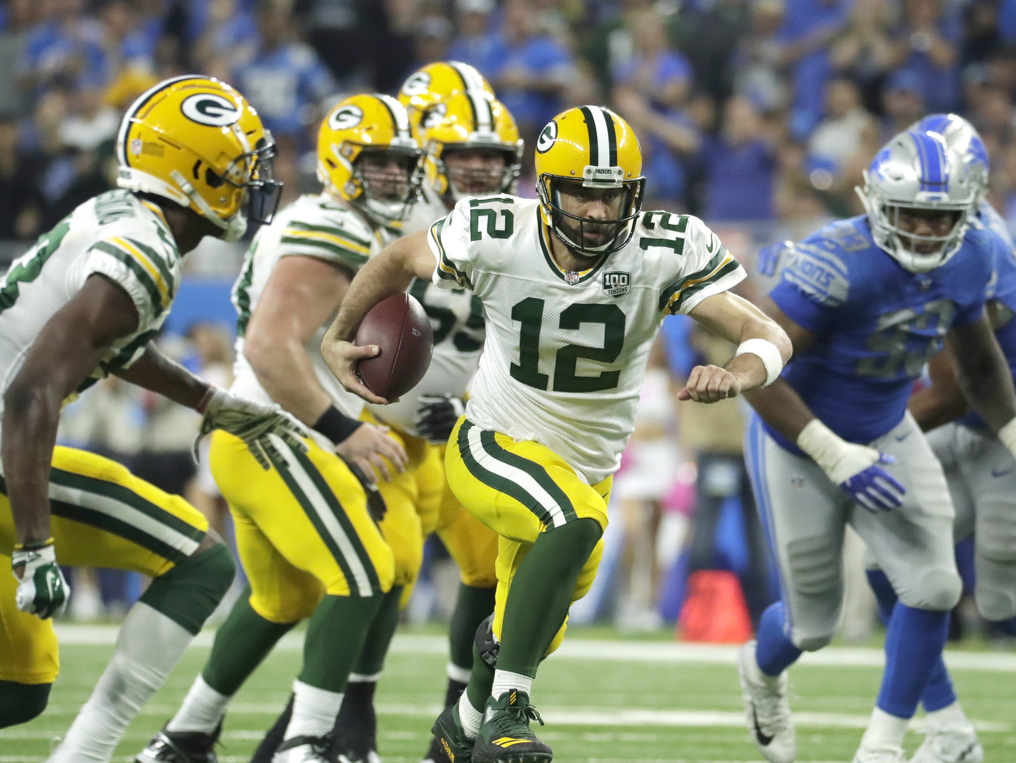 Green Bay Packers quarterback Aaron Rodgers (12) scrambles on 4th and 4 for a first down in the second half during the Green Bay Packers 31-23 loss to the Detroit Lions at Ford Field, Detroit, Sunday, October 7, 2018.