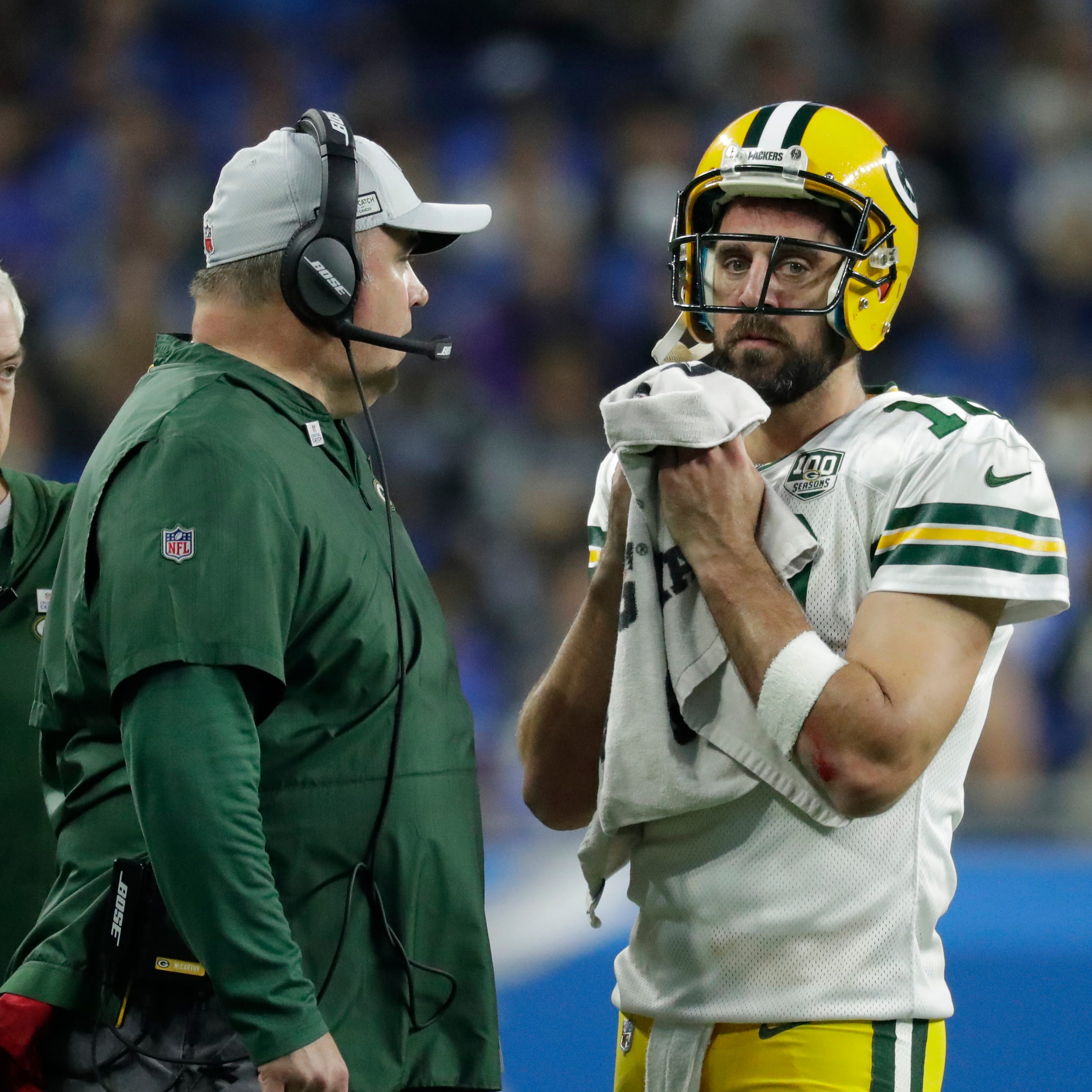 Coach Mike McCarthy talks with Green Bay Packers quarterback Aaron Rodgers (12) during a second half break during the Green Bay Packers 31-23 loss to the Detroit Lions at Ford Field, Detroit, Sunday, October 7, 2018.   Rick Wood/Milwaukee Journal Sentinel. USA