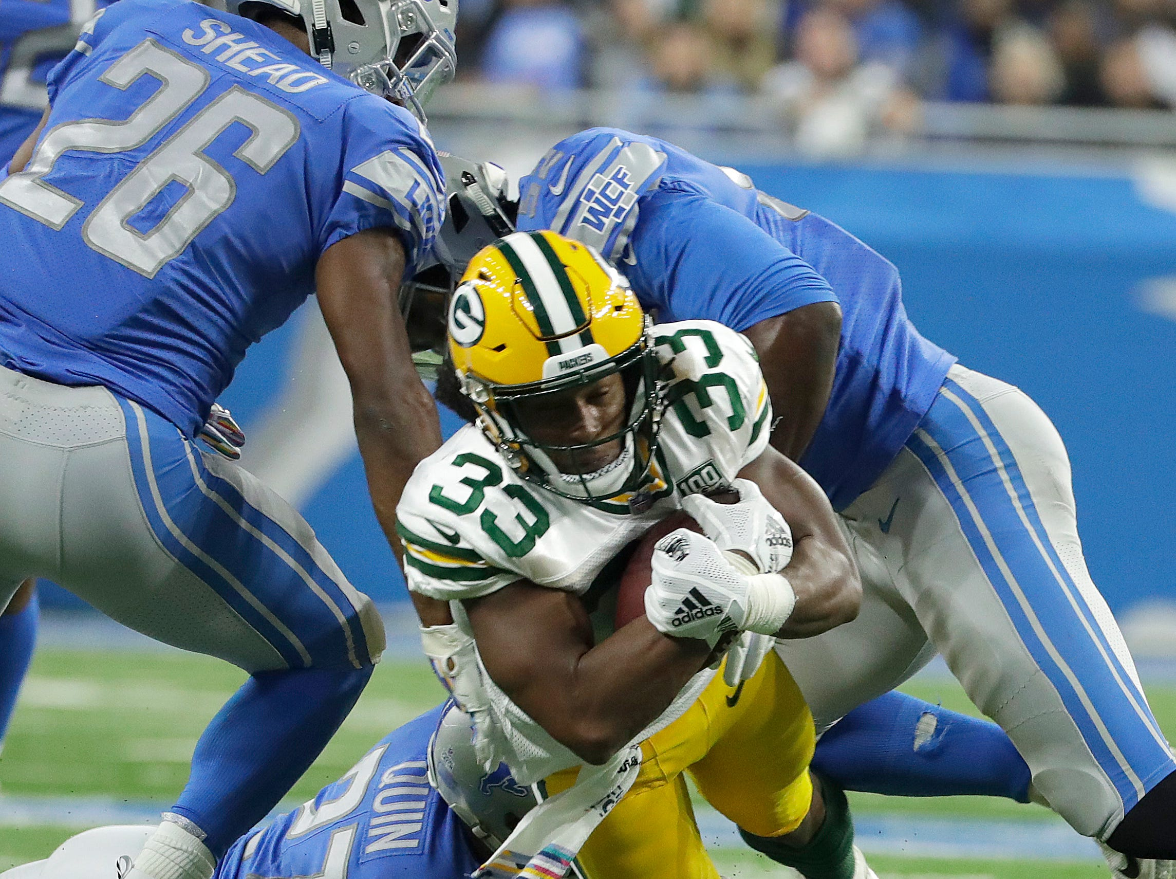 Green Bay Packers running back Aaron Jones (33) picks up 4 yards in the first half during the Green Bay Packers vs. Detroit Lions NFL game at Ford Field, Detroit, Sunday, October 7, 2018.   Rick Wood/Milwaukee Journal Sentinel. USA