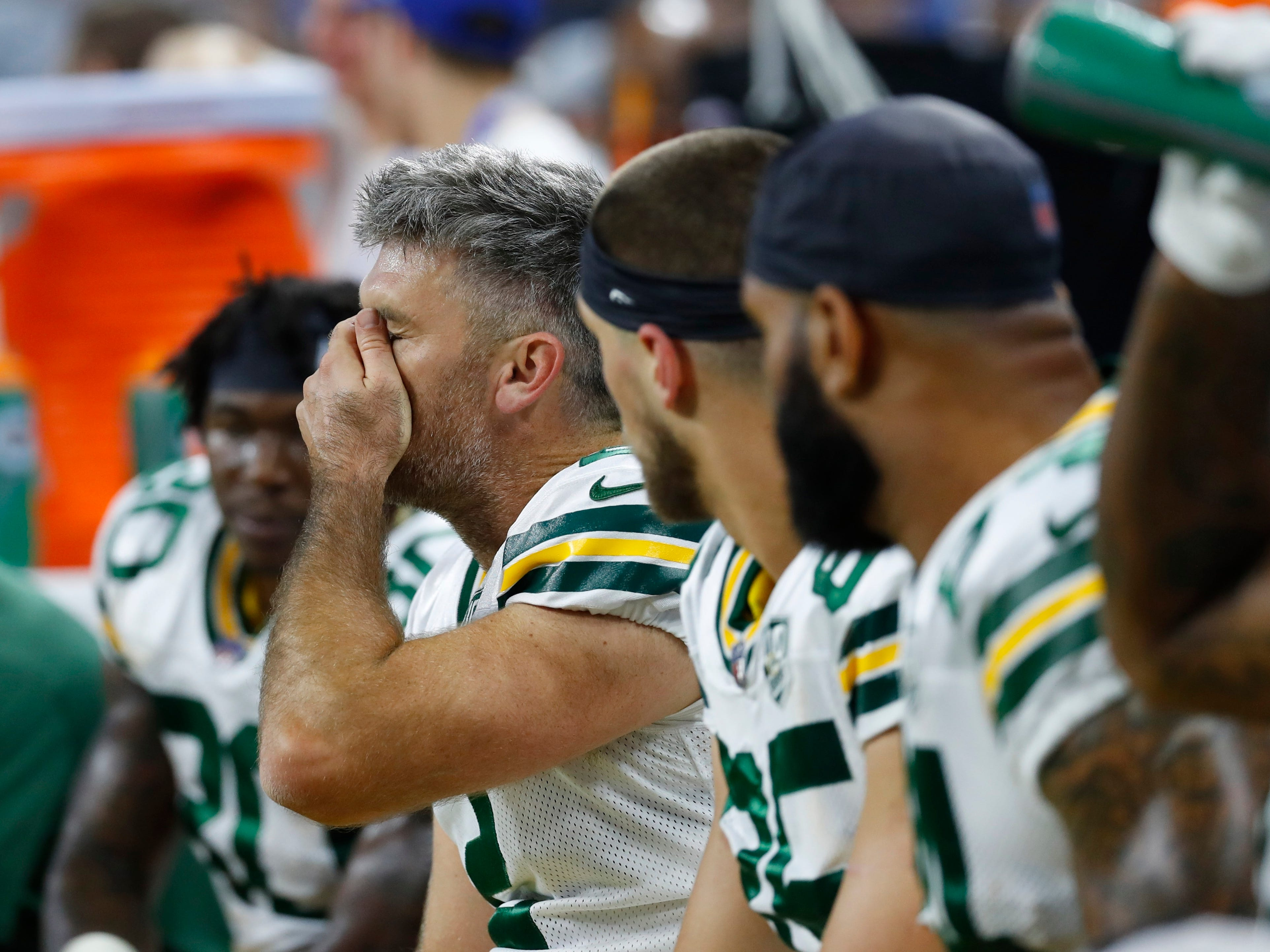 Green Bay Packers kicker Mason Crosby wipes his face on the bench after missing his third field goal of the day during the first half of an NFL football game against the Detroit Lions, Sunday, Oct. 7, 2018, in Detroit.