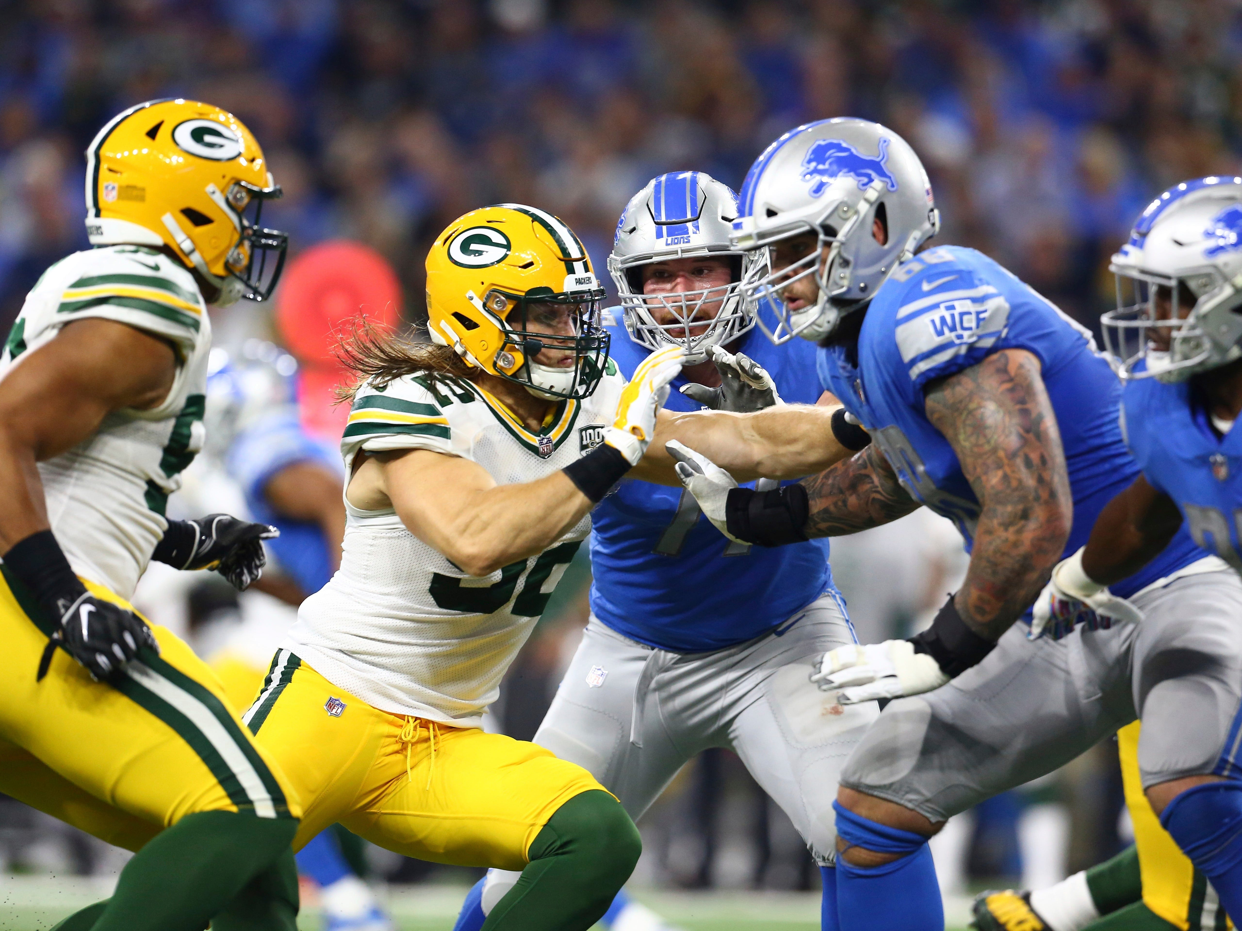 Green Bay Packers linebacker Clay Matthews, center, leads the tackle during the first half of an NFL football game against the Detroit Lions, Sunday, Oct. 7, 2018, in Detroit.