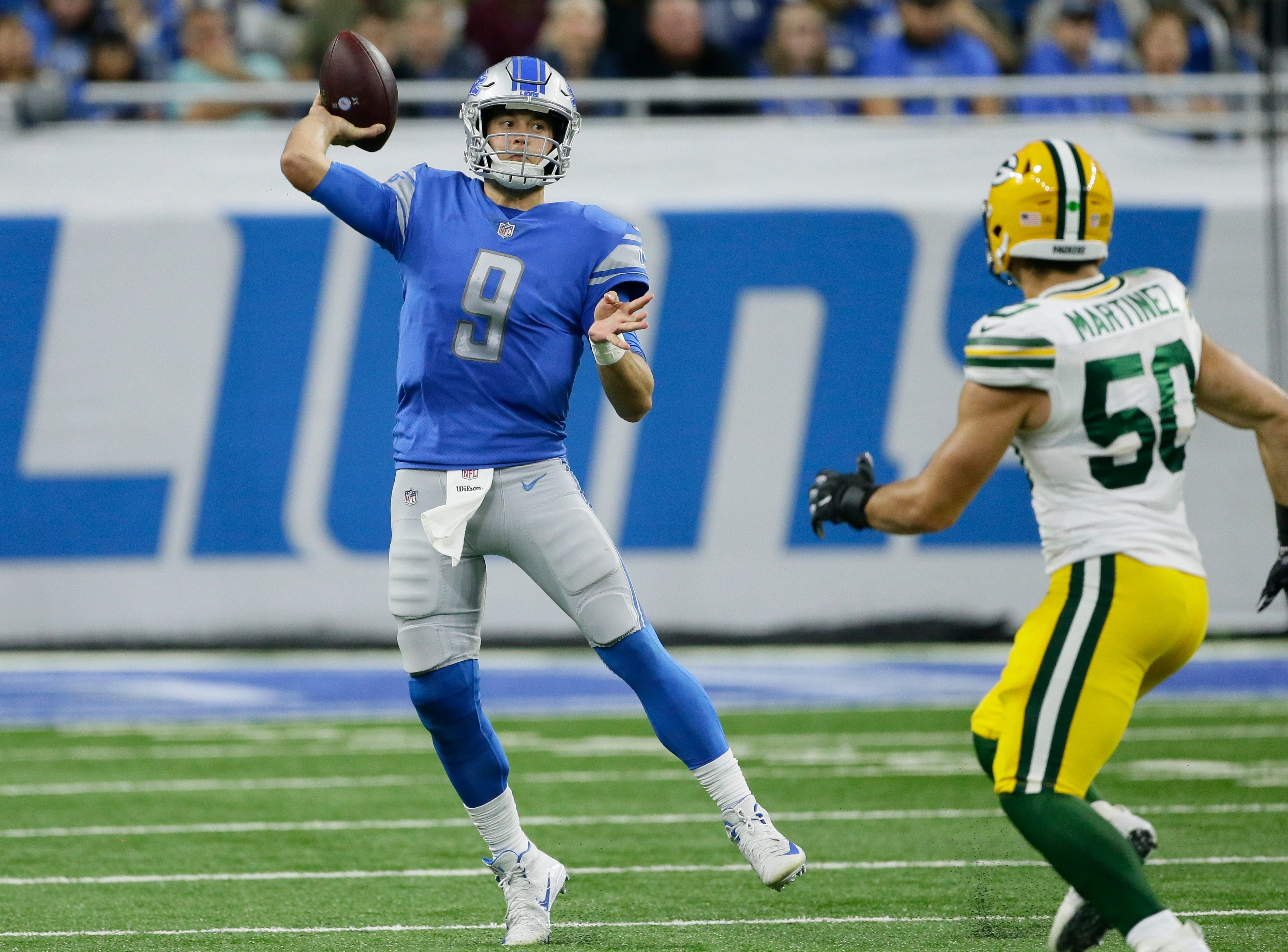 Detroit Lions quarterback Matthew Stafford (9) throws as Green Bay Packers linebacker Blake Martinez (50) rushes during the second half of an NFL football game, Sunday, Oct. 7, 2018, in Detroit.