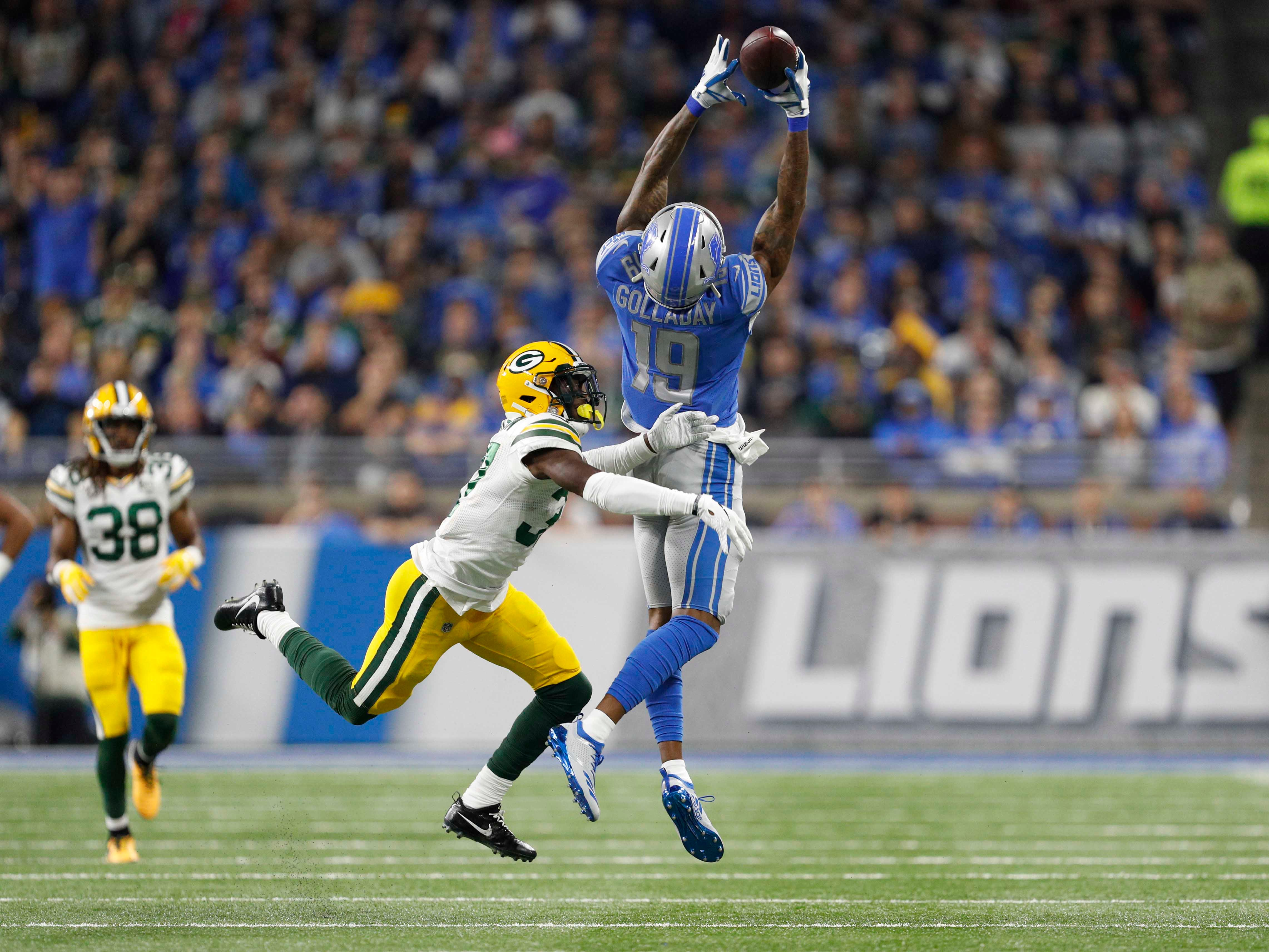 Oct 7, 2018; Detroit, MI, USA; Detroit Lions wide receiver Kenny Golladay (19) makes a catch during the first quarter against Green Bay Packers cornerback Josh Jackson (37) at Ford Field.