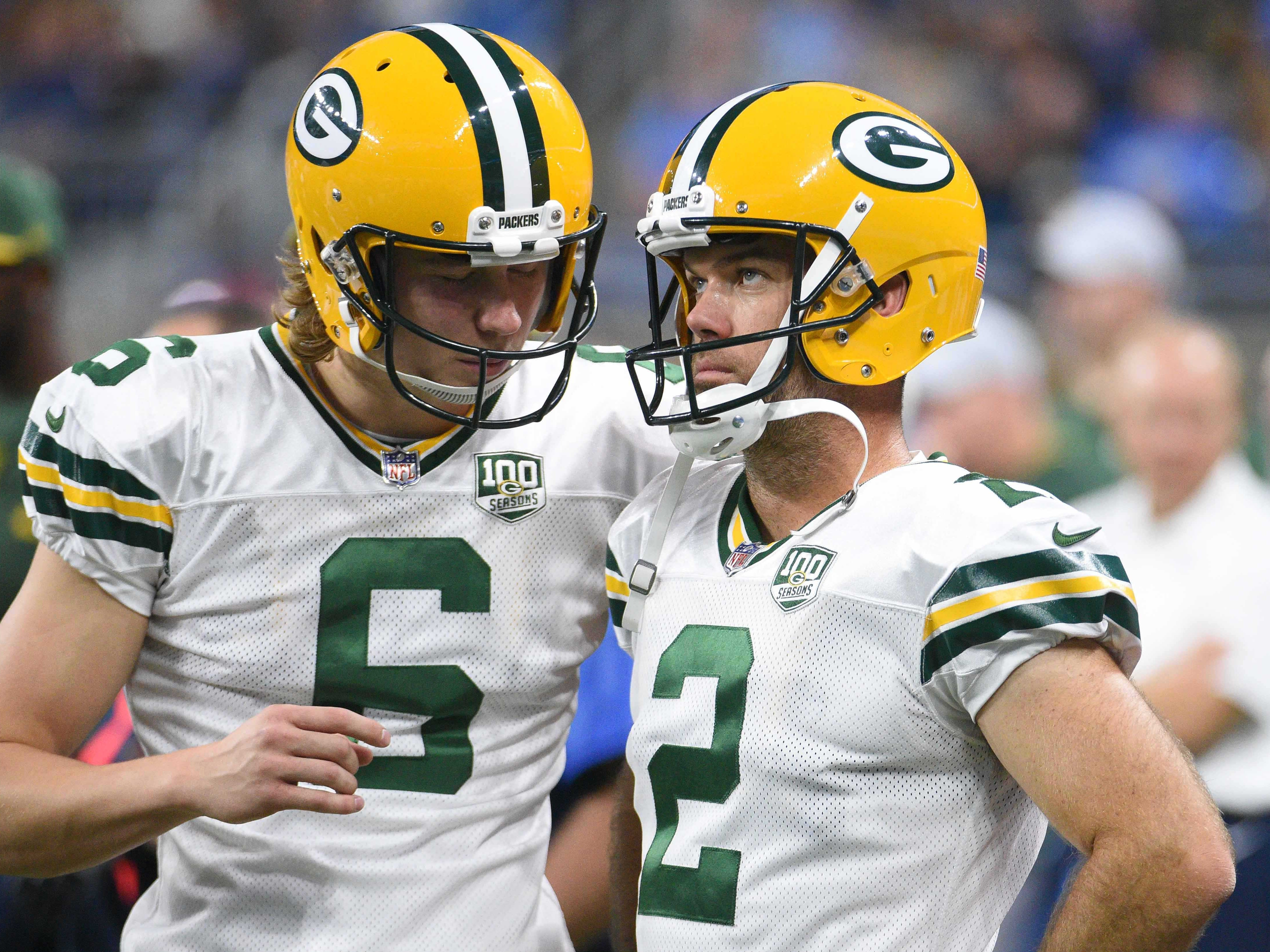 Oct 7, 2018; Detroit, MI, USA; Green Bay Packers kicker Mason Crosby (2) talks to punter JK Scott (6) on the sidelines after a missed field goal during the game against the Detroit Lions at Ford Field. Mandatory Credit: Tim Fuller-USA TODAY Sports
