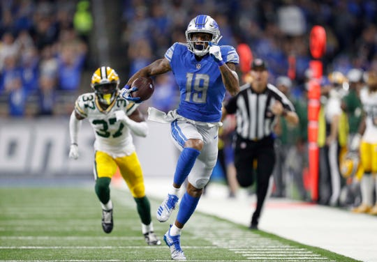 Oct 7, 2018; Detroit, MI, USA; Detroit Lions wide receiver Kenny Golladay (19) runs after a catch during the first quarter against Green Bay Packers cornerback Josh Jackson (37) at Ford Field.