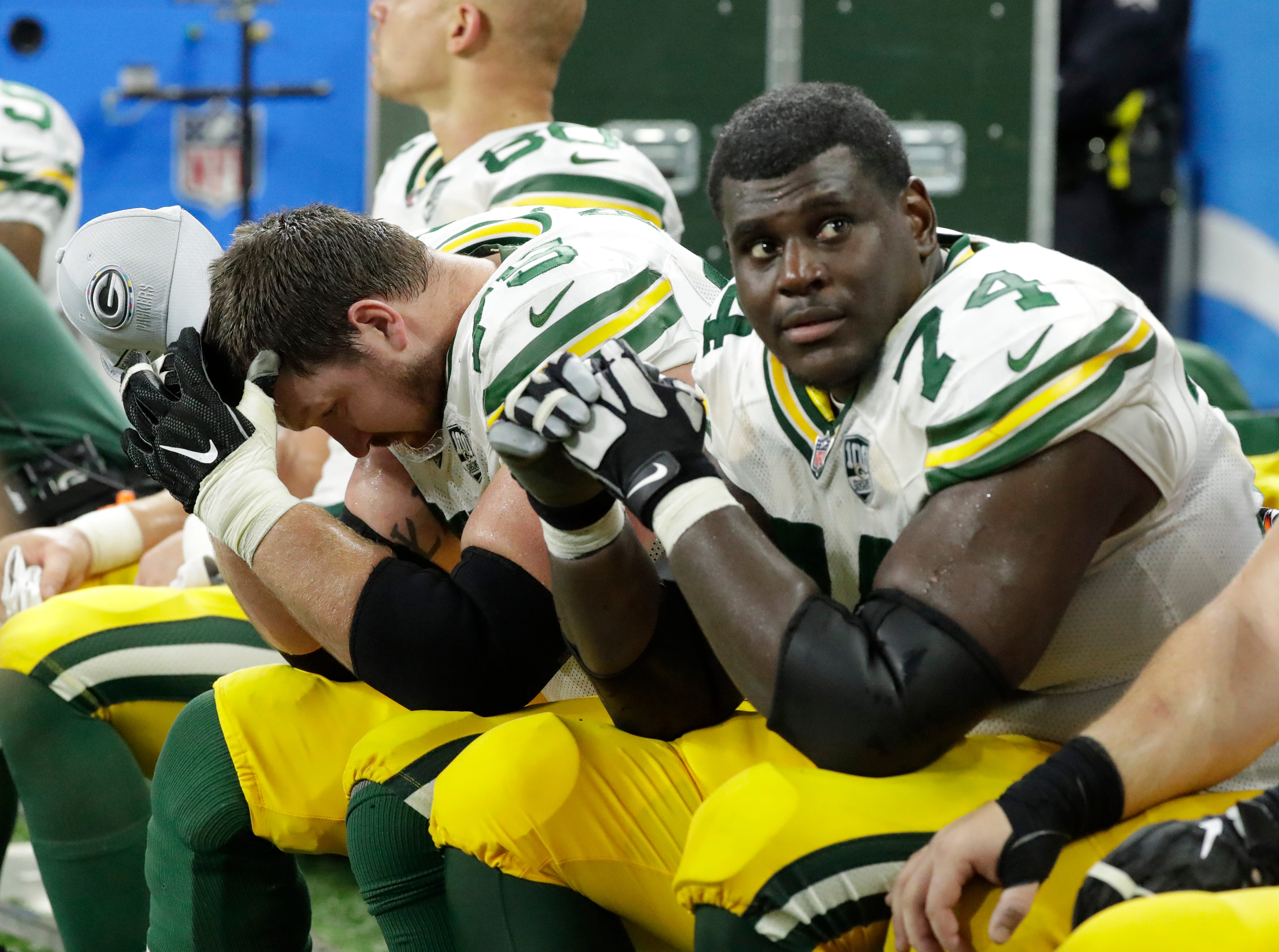 Green Bay Packers offensive tackle Bryan Bulaga (75) and Green Bay Packers offensive tackle Byron Bell (74) rest at the end of the game during the Green Bay Packers 31-23 loss to the Detroit Lions at Ford Field, Detroit, Sunday, October 7, 2018.   Rick Wood/Milwaukee Journal Sentinel. USA