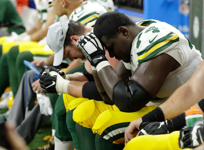 Green Bay Packers offensive tackle Bryan Bulaga (75) and Green Bay Packers offensive tackle Byron Bell (74) shows their fatigue at the end of the Green Bay Packers 31-23 loss to the Detroit Lions at Ford Field, Detroit, Sunday, October 7, 2018.   Rick Wood/Milwaukee Journal Sentinel. USA