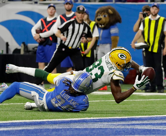 Green Bay Packers wide receiver Marquez Valdes-Scantling (83) stretches to try for a touchdown but on review is placed at the 2 yard line  during the Green Bay Packers 31-23 loss to the Detroit Lions at Ford Field, Detroit, Sunday, October 7, 2018.   Rick Wood/Milwaukee Journal Sentinel. USA