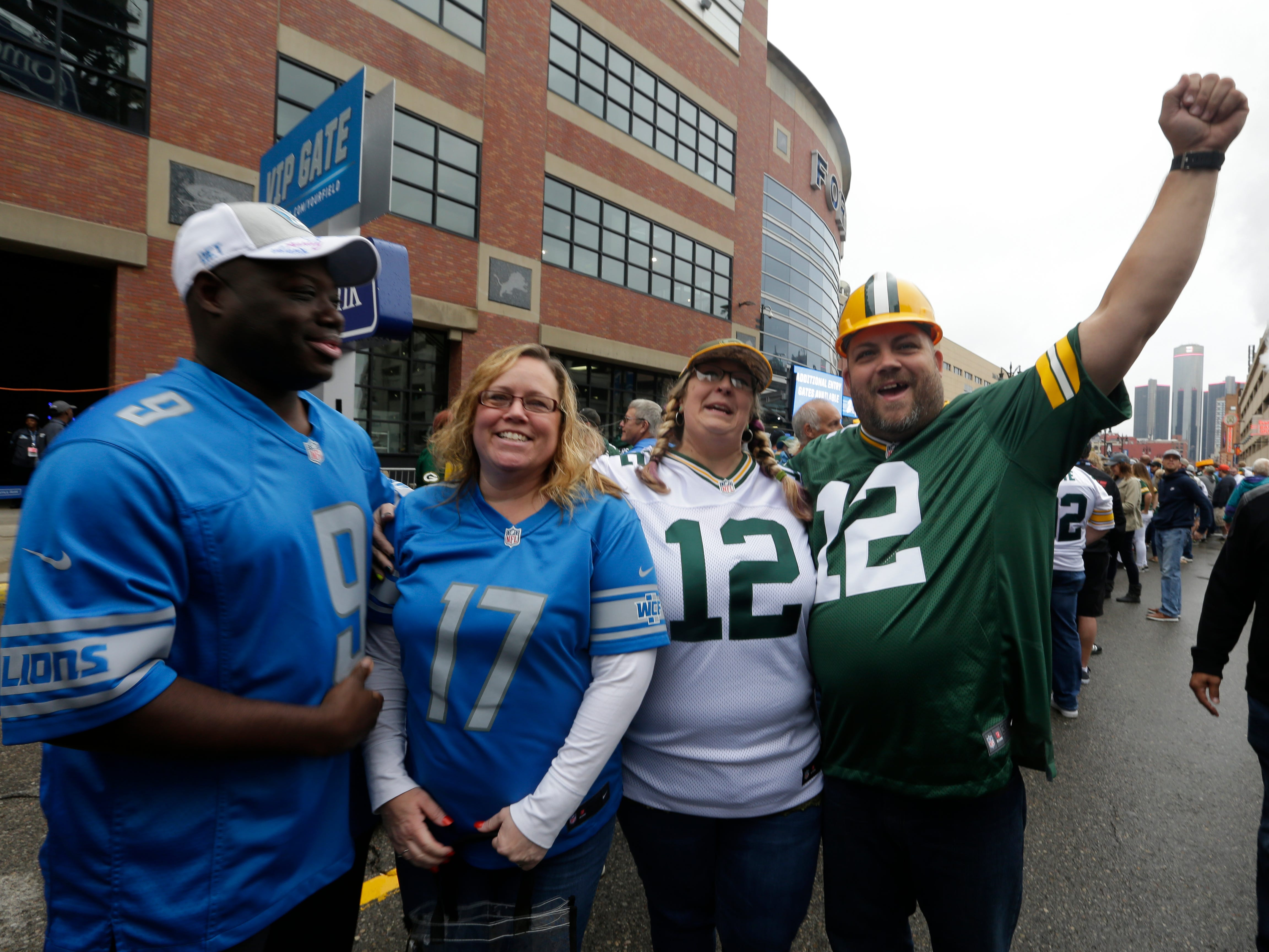 Al and Nancy Phillips and Shawna Lawson and Bill Lawson, from Ann Arbor, show their friendly rivalry before  the Green Bay Packers vs. Detroit Lions NFL game at Ford Field, Detroit, Sunday, October 7, 2018.
