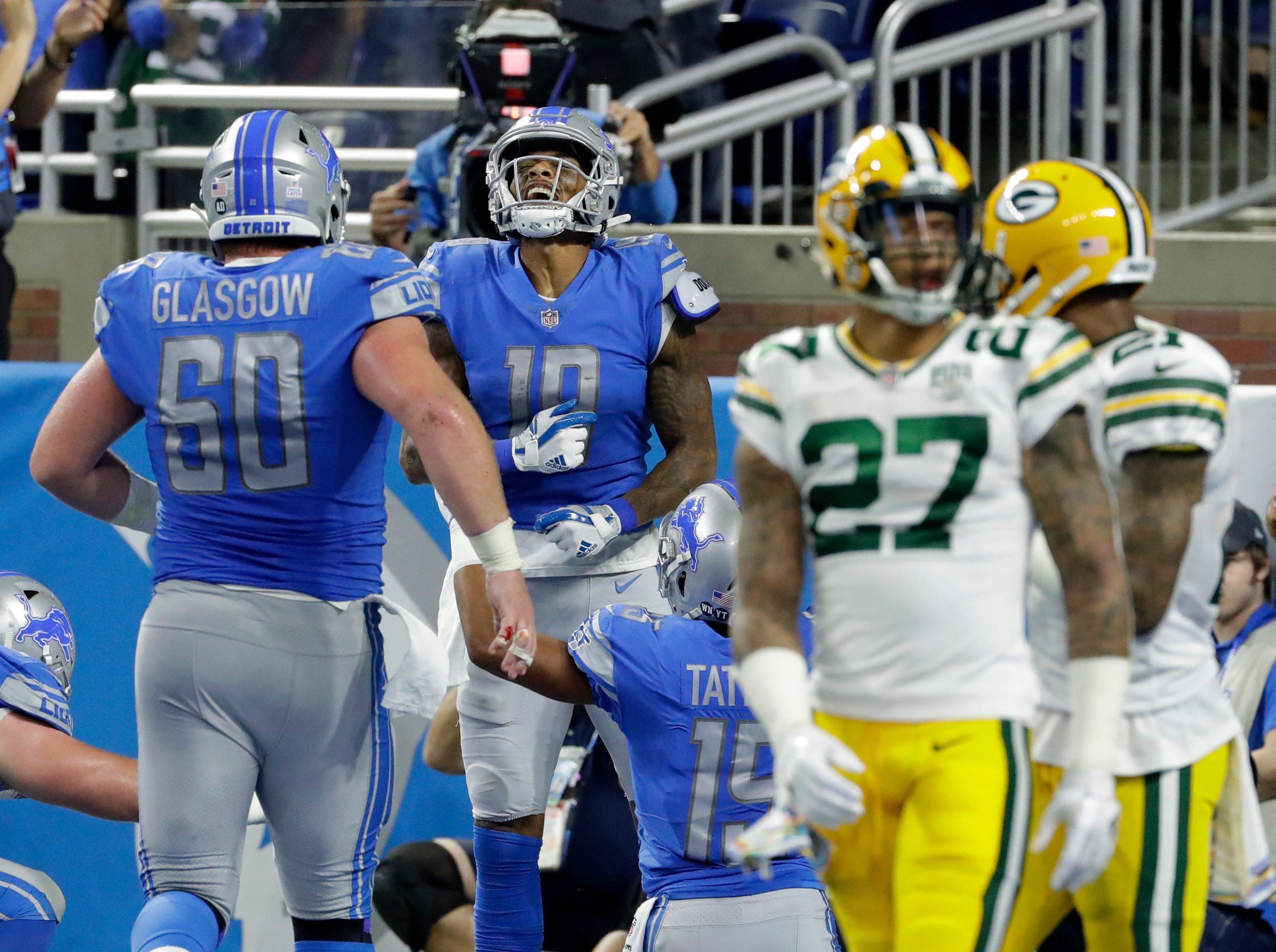 \Detroit Lions wide receiver Kenny Golladay (19) celebrates a td while the Packers secondary appears lost during the Green Bay Packers 31-23 loss to the Detroit Lions at Ford Field, Detroit, Sunday, October 7, 2018.   Rick Wood/Milwaukee Journal Sentinel. USA