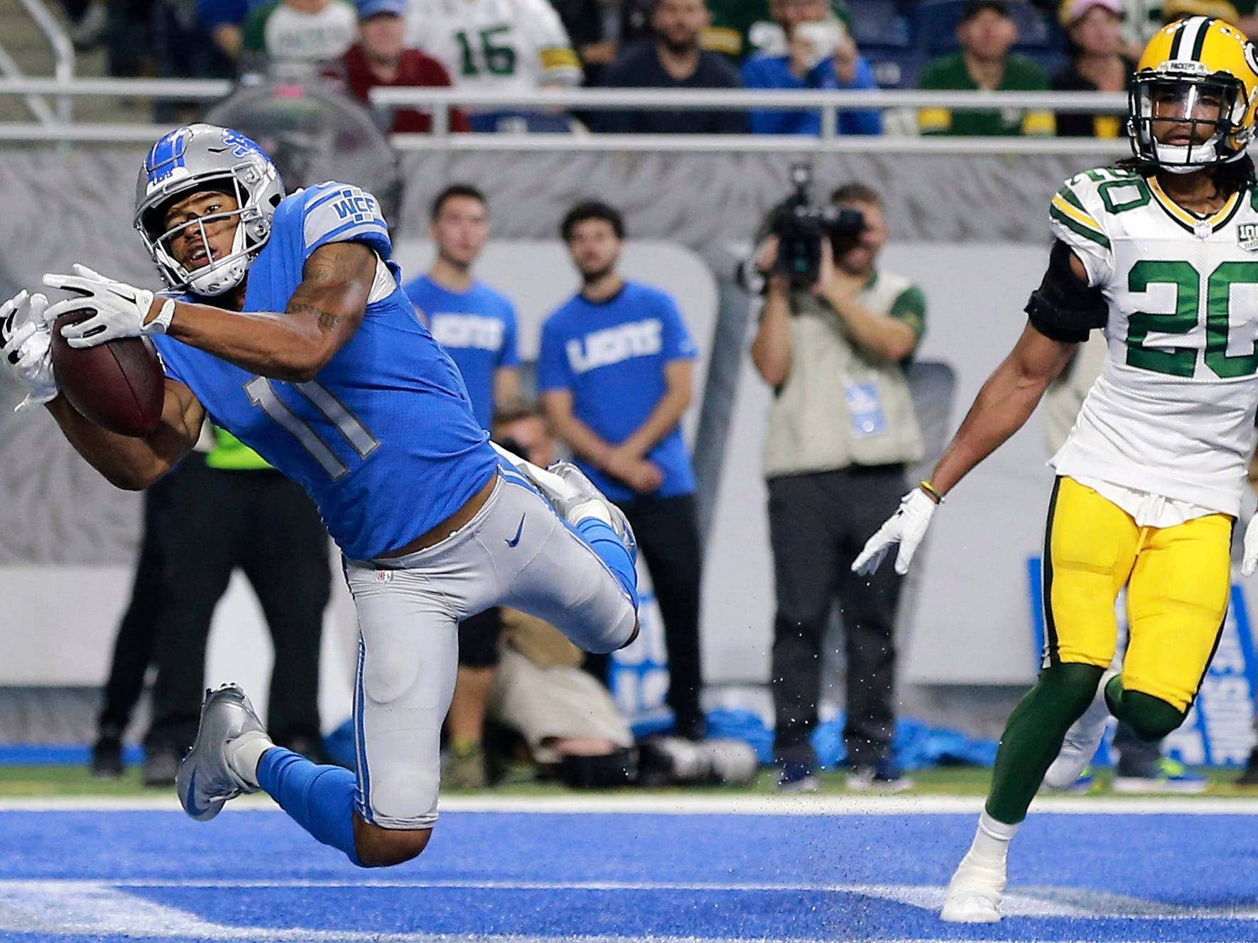 Detroit Lions wide receiver Marvin Jones (11), defended by Green Bay Packers cornerback Kevin King (20), catches an 8-yard pass for a touchdown during the first half of an NFL football game, Sunday, Oct. 7, 2018, in Detroit.