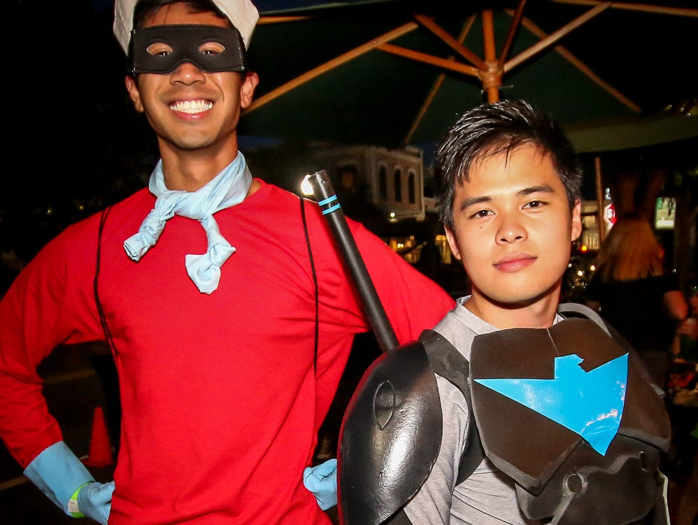 Good and evil met in the middle as hundreds of people joined in the Tsunami Promotions' Superhero and Villain Bar Crawl in downtown Pensacola on Saturday, October 6, 2018.