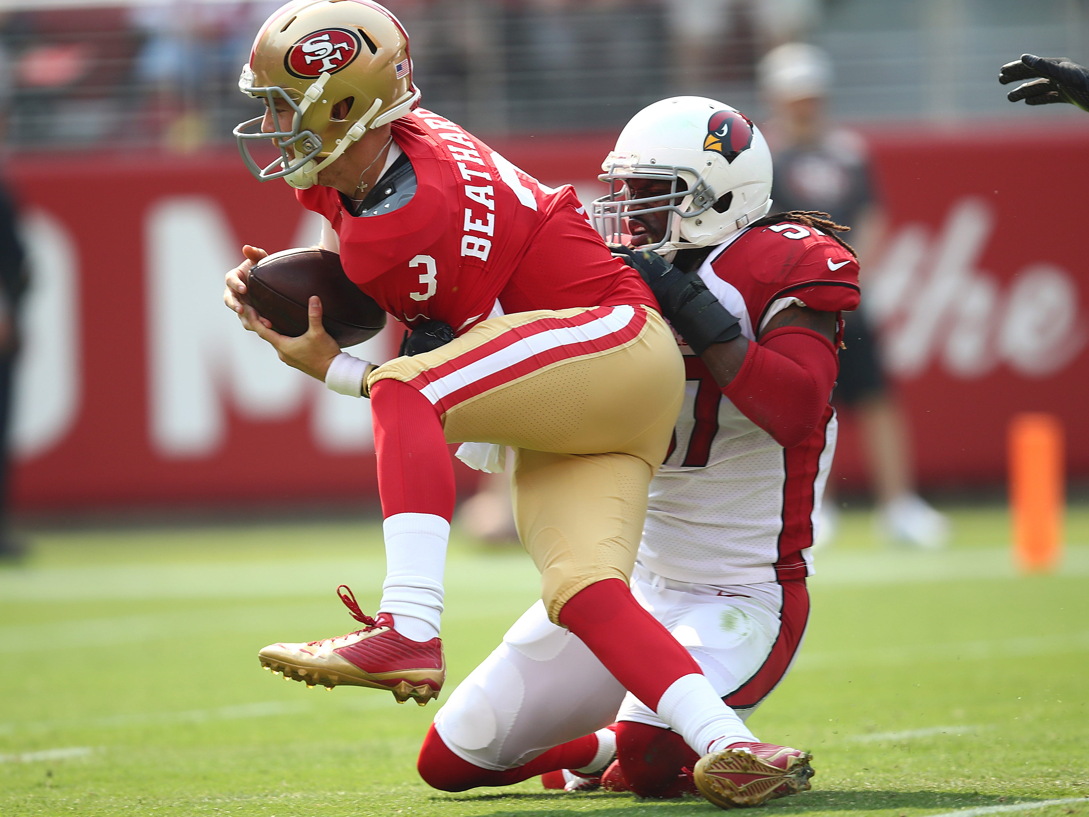 Arizona Cardinals linebacker Josh Bynes (57) sacks San Francisco 49ers quarterback C.J. Beathard (3) during the first half of an NFL football game in Santa Clara, Calif., Sunday, Oct. 7, 2018.