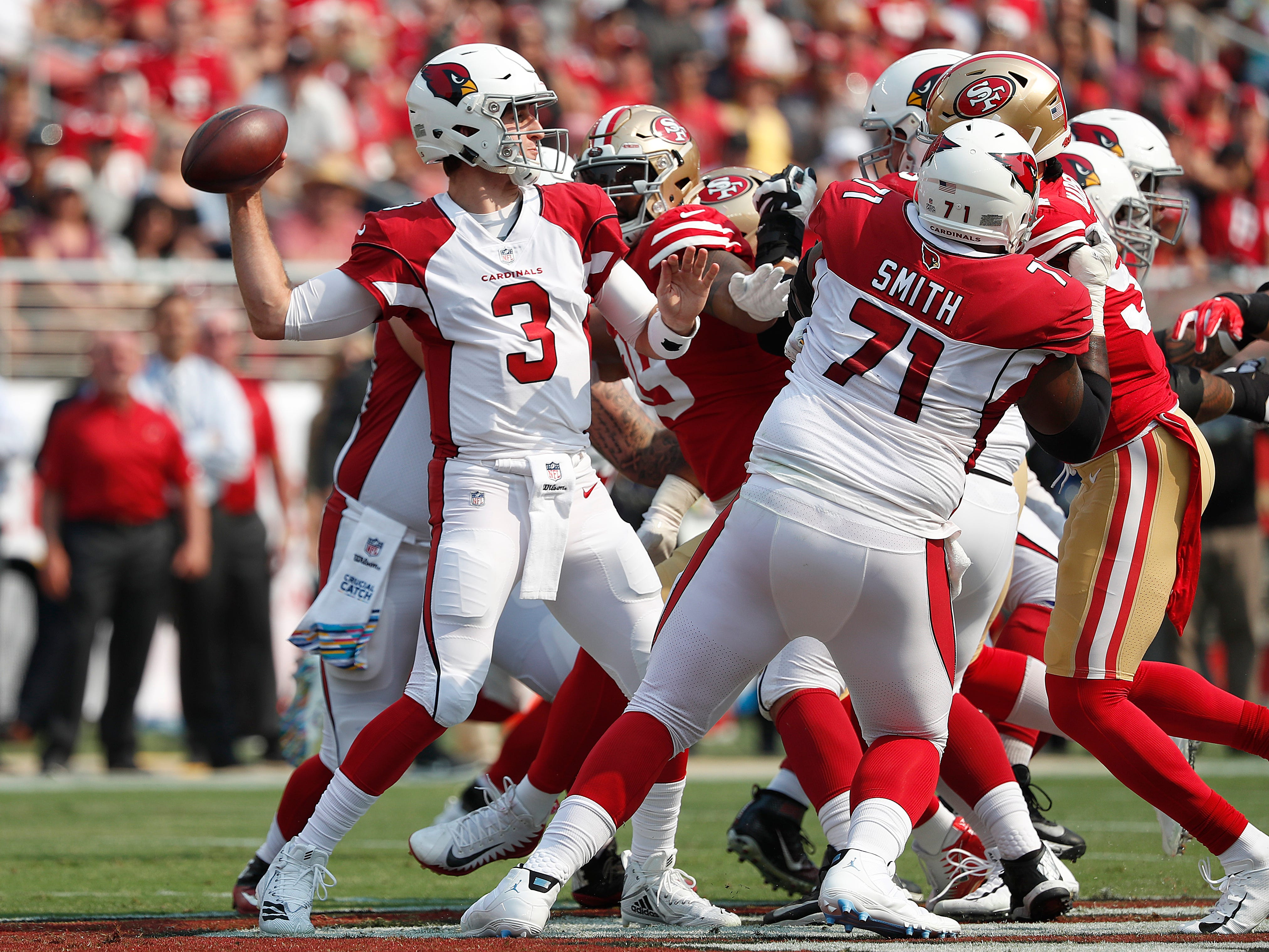 Arizona Cardinals quarterback Josh Rosen (3) passes against the San Francisco 49ers during the first half of an NFL football game in Santa Clara, Calif., Sunday, Oct. 7, 2018.