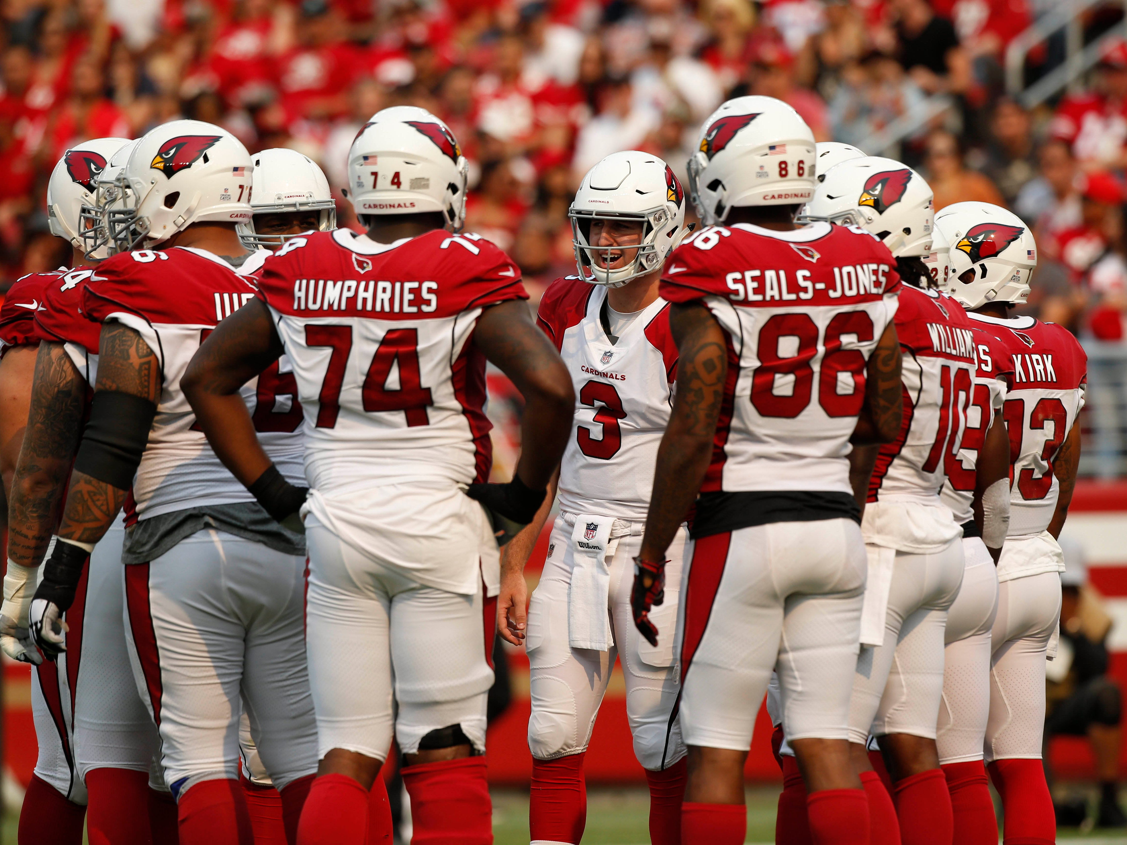Oct 7, 2018; Santa Clara, CA, USA; Arizona Cardinals quarterback Josh Rosen (3) stands in the huddle against the San Francisco 49ers in the second quarter at Levi's Stadium.