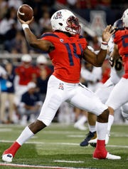 Arizona quarterback Khalil Tate (14) throws a pass during the first half of an NCAA college football game against California on Saturday, Oct. 6, 2018, in Tucson, Ariz. (AP Photo/Chris Coduto)