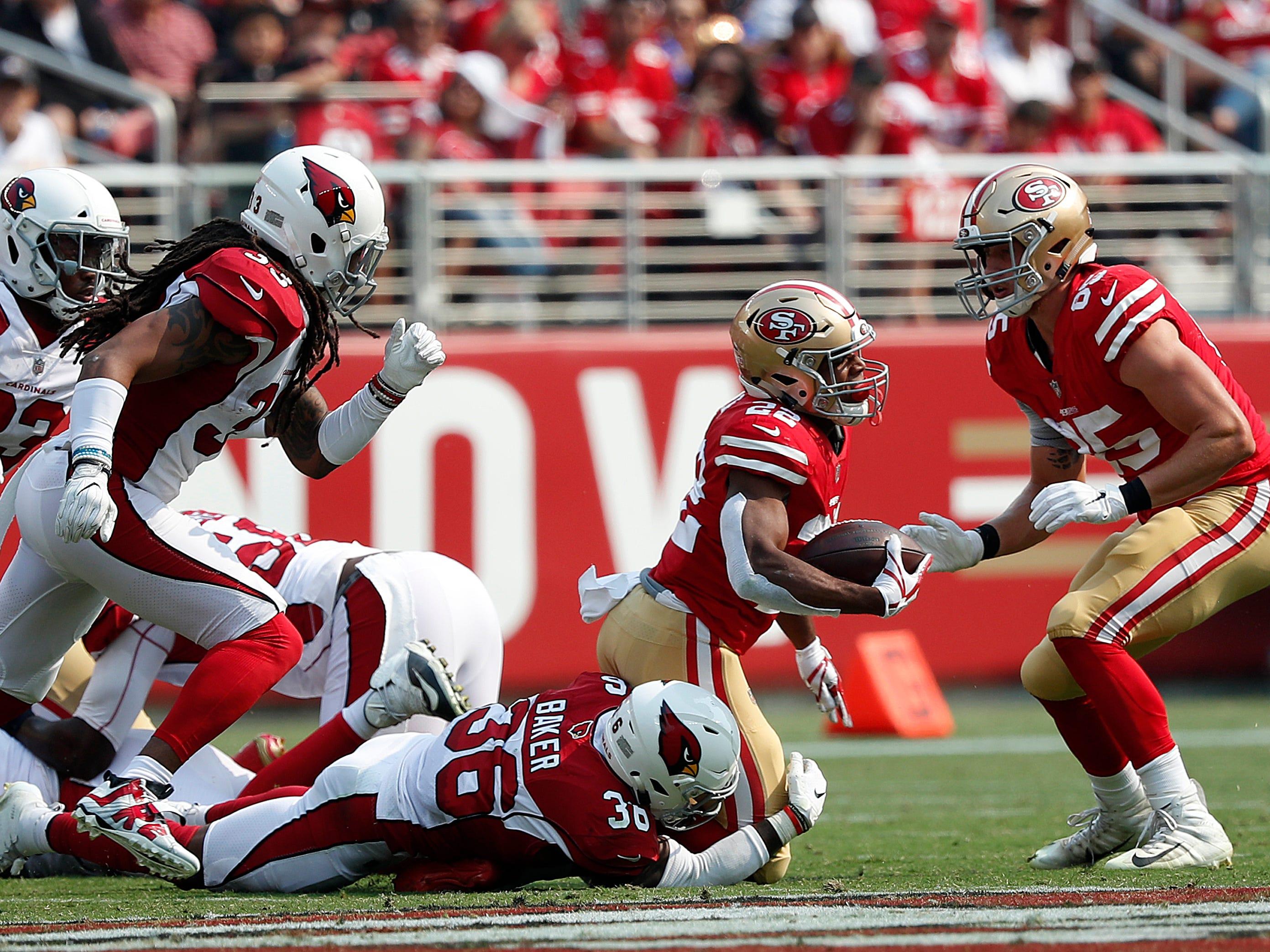 San Francisco 49ers running back Matt Breida (22) is tackled by Arizona Cardinals safety Budda Baker (36) during the first half of an NFL football game in Santa Clara, Calif., Sunday, Oct. 7, 2018.