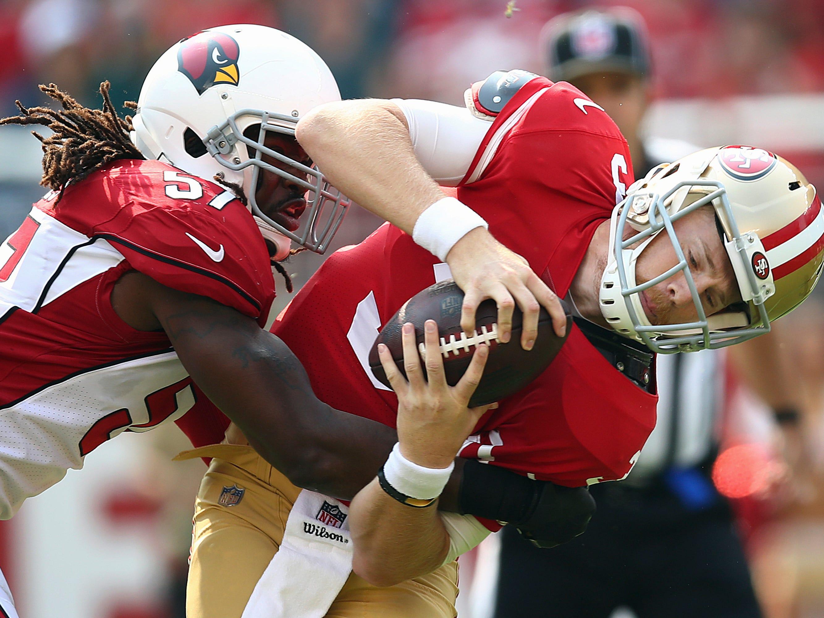Arizona Cardinals linebacker Josh Bynes (57) sacks San Francisco 49ers quarterback C.J. Beathard (3) during the first half of an NFL football game in Santa Clara, Calif., Sunday, Oct. 7, 2018.
