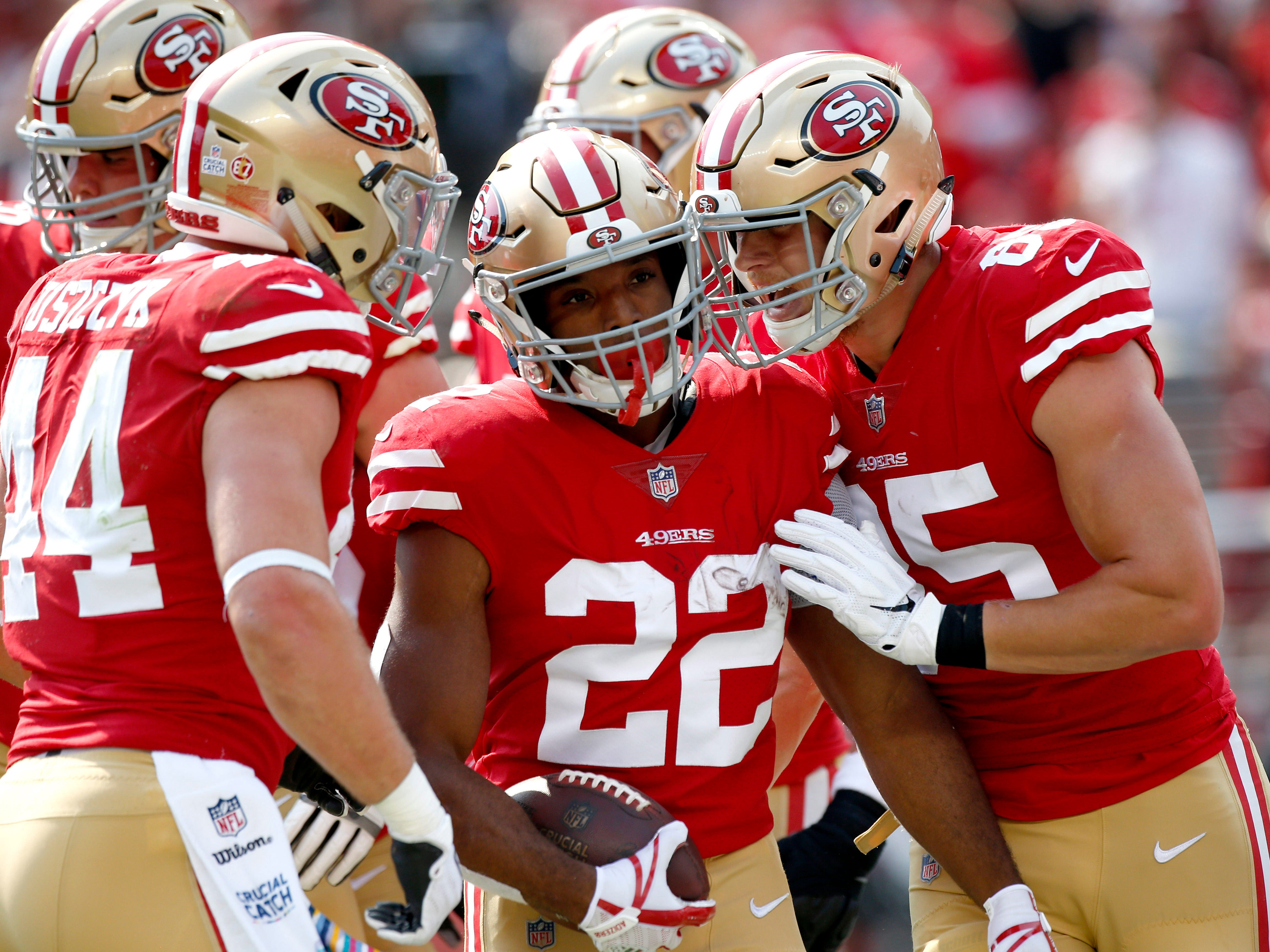 Oct 7, 2018; Santa Clara, CA, USA; San Francisco 49ers running back Matt Breida (22) is congratulated by tight end George Kittle (85) after scoring a touchdown against the Arizona Cardinals in the first quarter at Levi's Stadium.