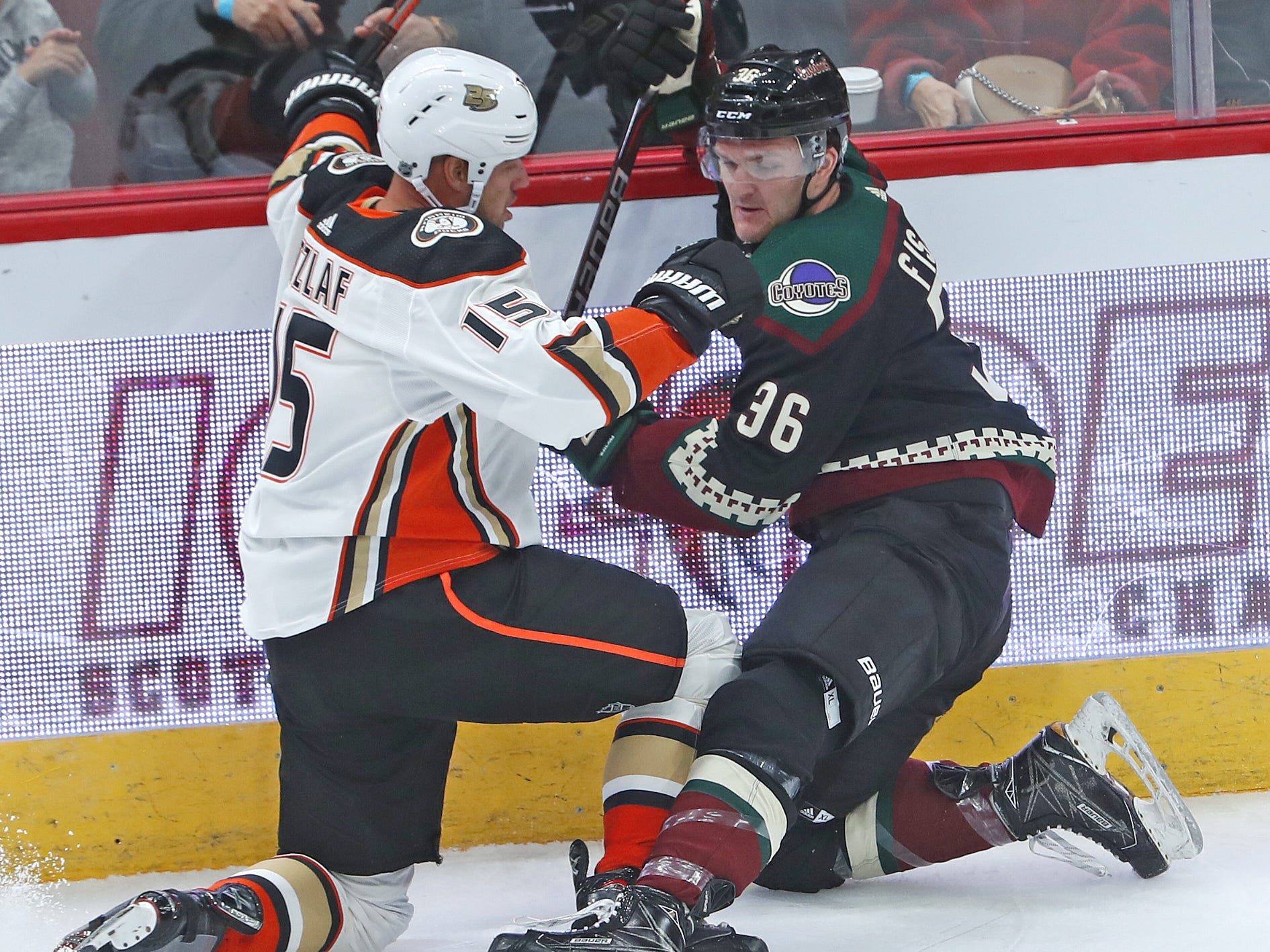 Coyotes Christian Fischer (36) and Ducks Ryan Getzlaf (15) fight for a loose puck during the first period at Gila River Arena in Glendale, Ariz. on October 6, 2018.