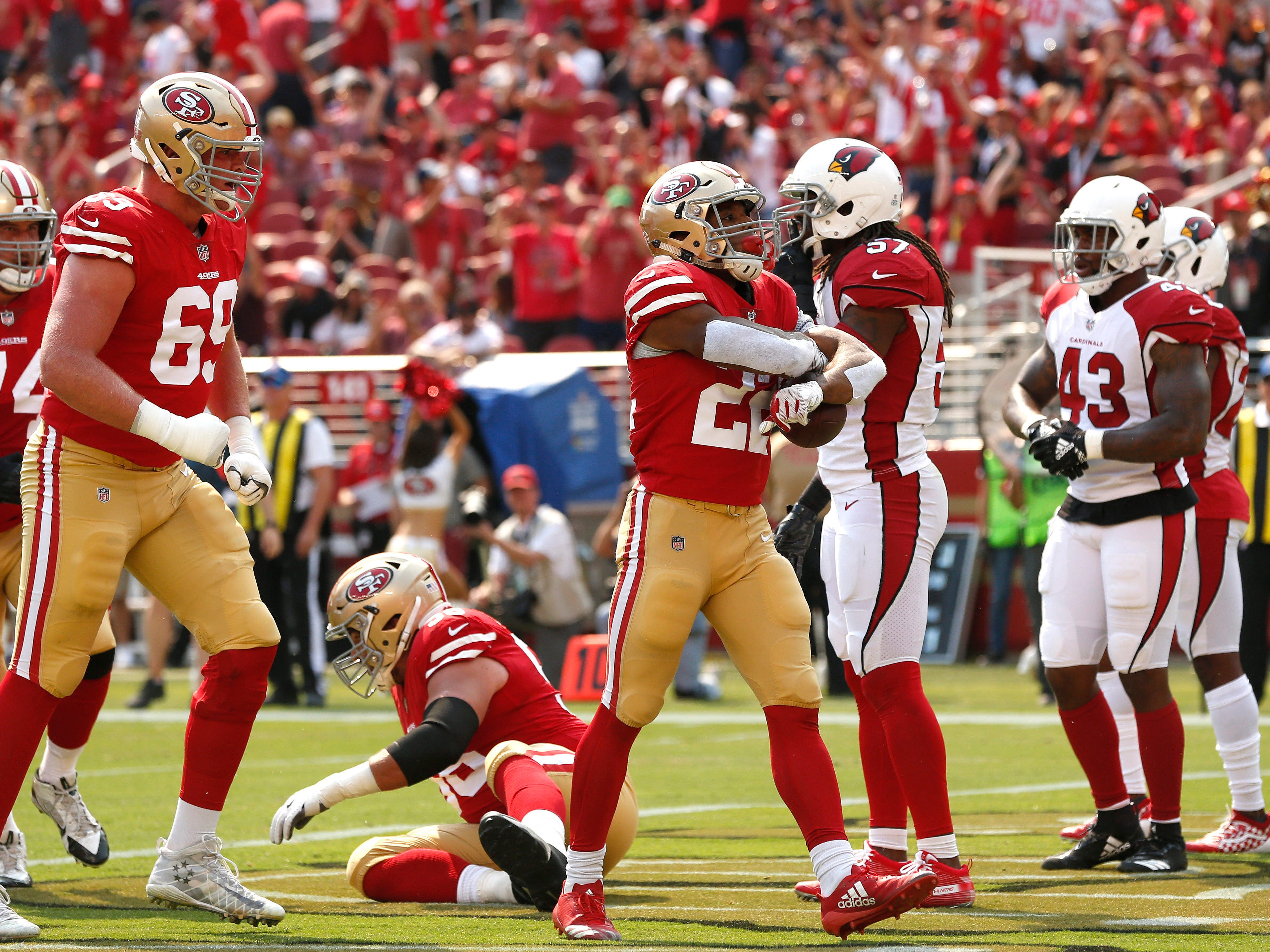 Oct 7, 2018; Santa Clara, CA, USA; San Francisco 49ers running back Matt Breida (22) reacts after scoring a touchdown against the Arizona Cardinals in the first quarter at Levi's Stadium.